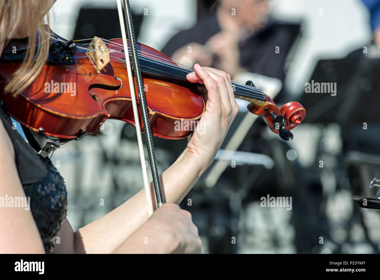 musician playing violin instrument on street concert. closeup view - Stock Image