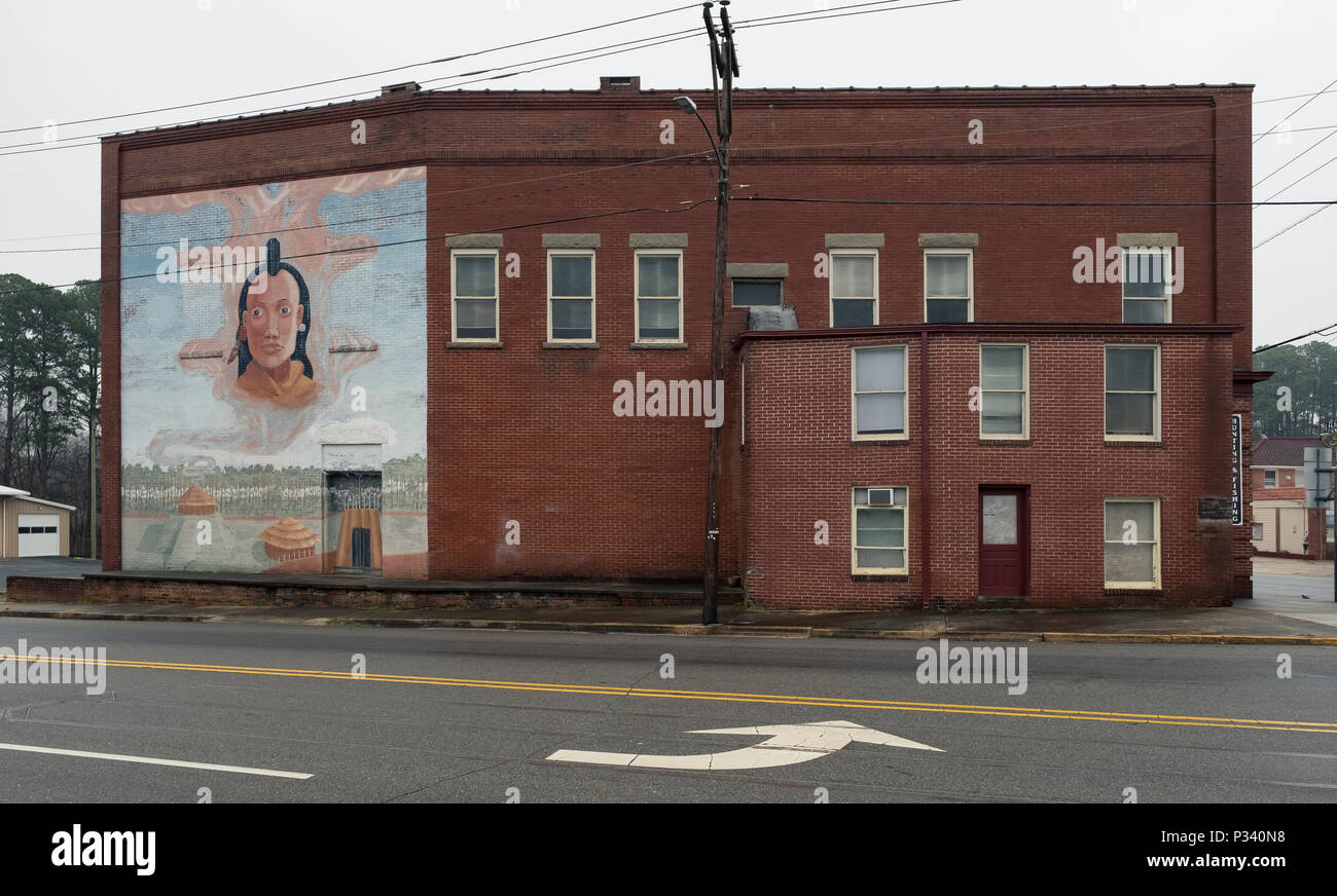 an historical document of art mural in the Mount Gilead, North Carolina circa 2018 at a building on main street of an Indian Village and farm by unkno Stock Photo