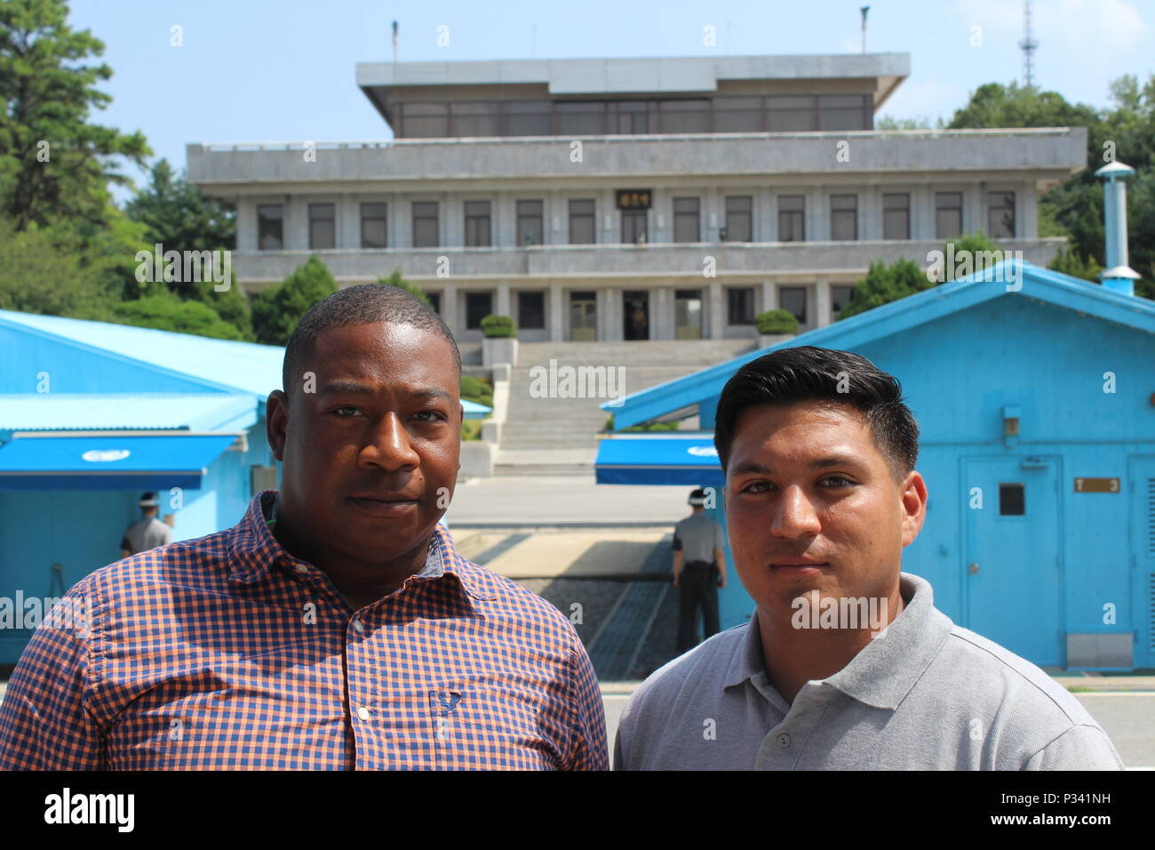 """Sgt. Byron Nunn and Spc. Salomn Garcia-Padilla, Forward Support Company J, 2nd Battalion, 8th Cavalry Regiment """"Stallions,"""" 1st Armored Brigade Combat Team, 1st Cavalry Division, visit the Joint Security Area in the Demilitarized Zone separating North and South Korea, as part of a tour Aug. 16. Soldiers visited the JSA, Camp Bonifas, the """"Bridge of No Return"""" and several other points of interest, during the tour. (U.S. Army photo by Spc. Jeremy Reuse, 2nd Battalion, 8th Cavalry Regiment, 1st Armored Brigade Combat Team, 1st Cav. Div.) Stock Photo"""
