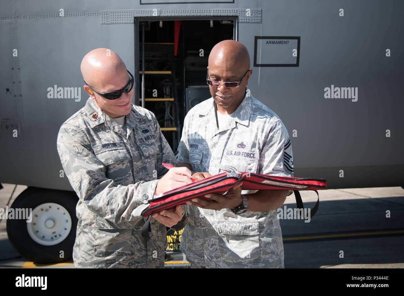 Maj. Brian Horton, 803rd Aircraft Maintenance Squadron commander and Senior Master Sgt. Marshall Harris, 803rd AMXS flight chief review an aircraft maintenance checklist Aug. 22. The 403rd Wing will be gaining the new 803rd Aircraft Maintenance Squadron during an activation ceremony Sept. 11. (U.S. Air Force photo/Senior Airman Heather Heiney) - Stock Image
