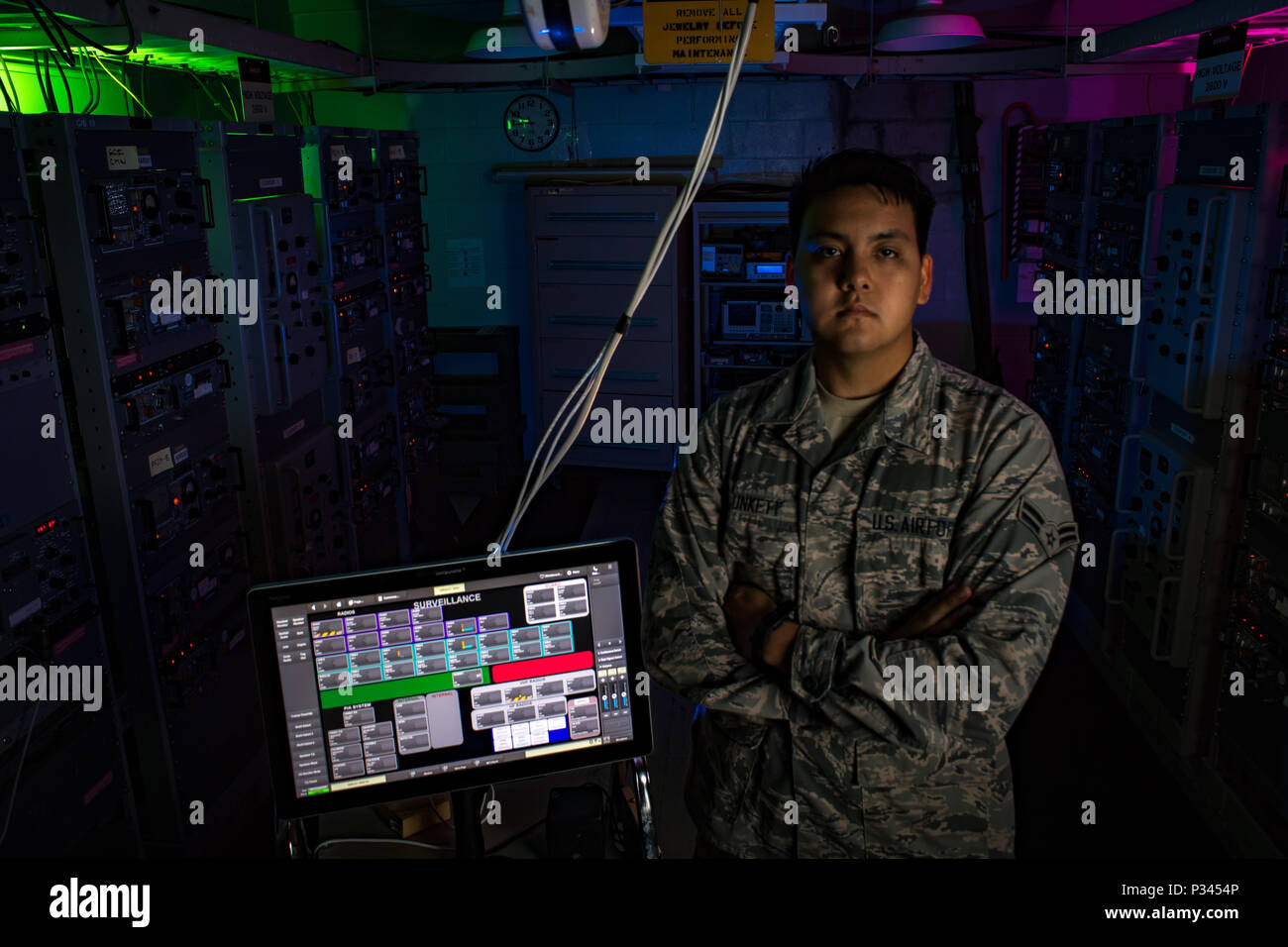 Airman 1st Class Kevin Plunkett, a radio frequency transmissions systems technician with the Hawaii Air National Guard's 169th Air Defense Squadron, stands in the radar equipment room located on Mt. Ka'ala Air Force station (AFS), Aug. 12, 2016, Oahu, Hawaii. Mt. Ka'ala AFS sits atop the highest point on the island of Oahu and houses the 169th ADS's radar equipment, which is used to monitor the airspace around the Hawaiian Islands. (U.S. Air Force photo by Tech. Sgt. Brandon Shapiro) Stock Photo