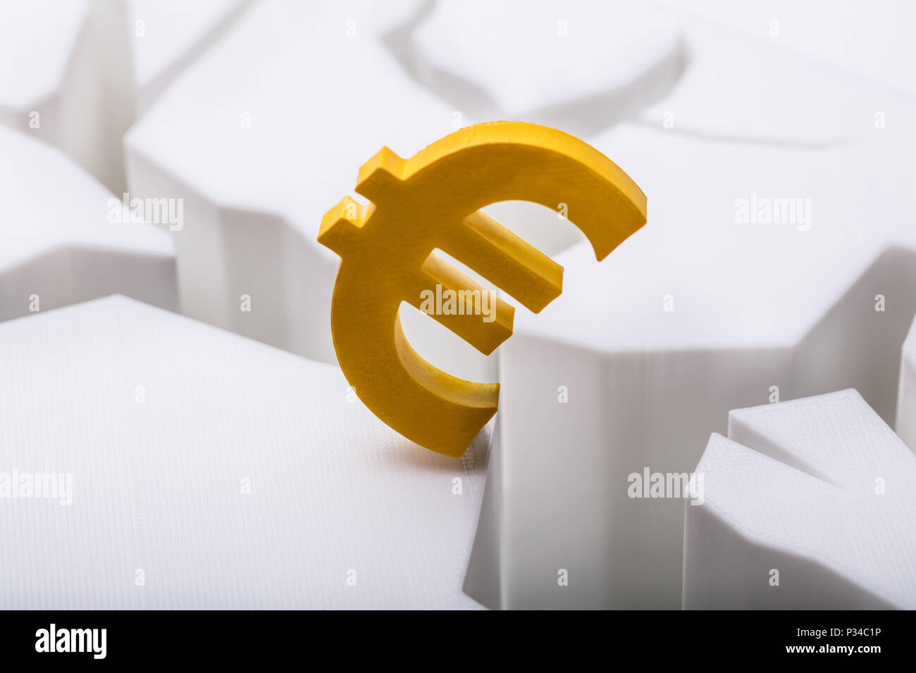 Close Up Of A Golden Euro Currency Symbol On Cracked White Surface