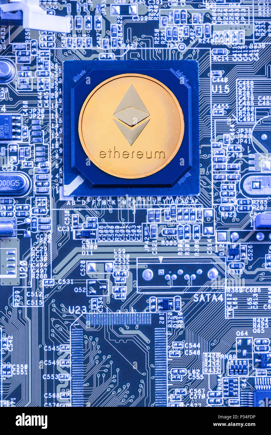 Printed circuit board with a processor and a ethereum symbol. The ...