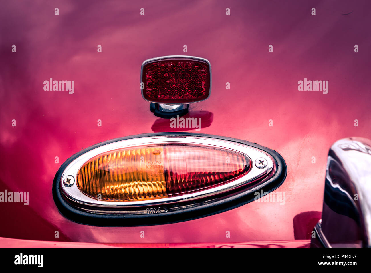 Close-up, detailed photo of the trunk and rear lamp of a classic oldtimer car. - Stock Image