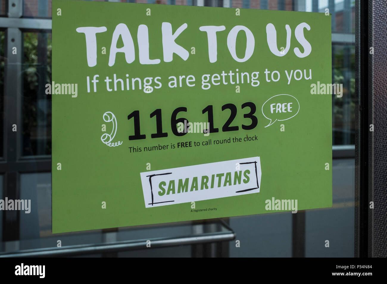Samaritans help sign on the platform of St.Albans city station, Hertfordshire, England, U.K. - Stock Image
