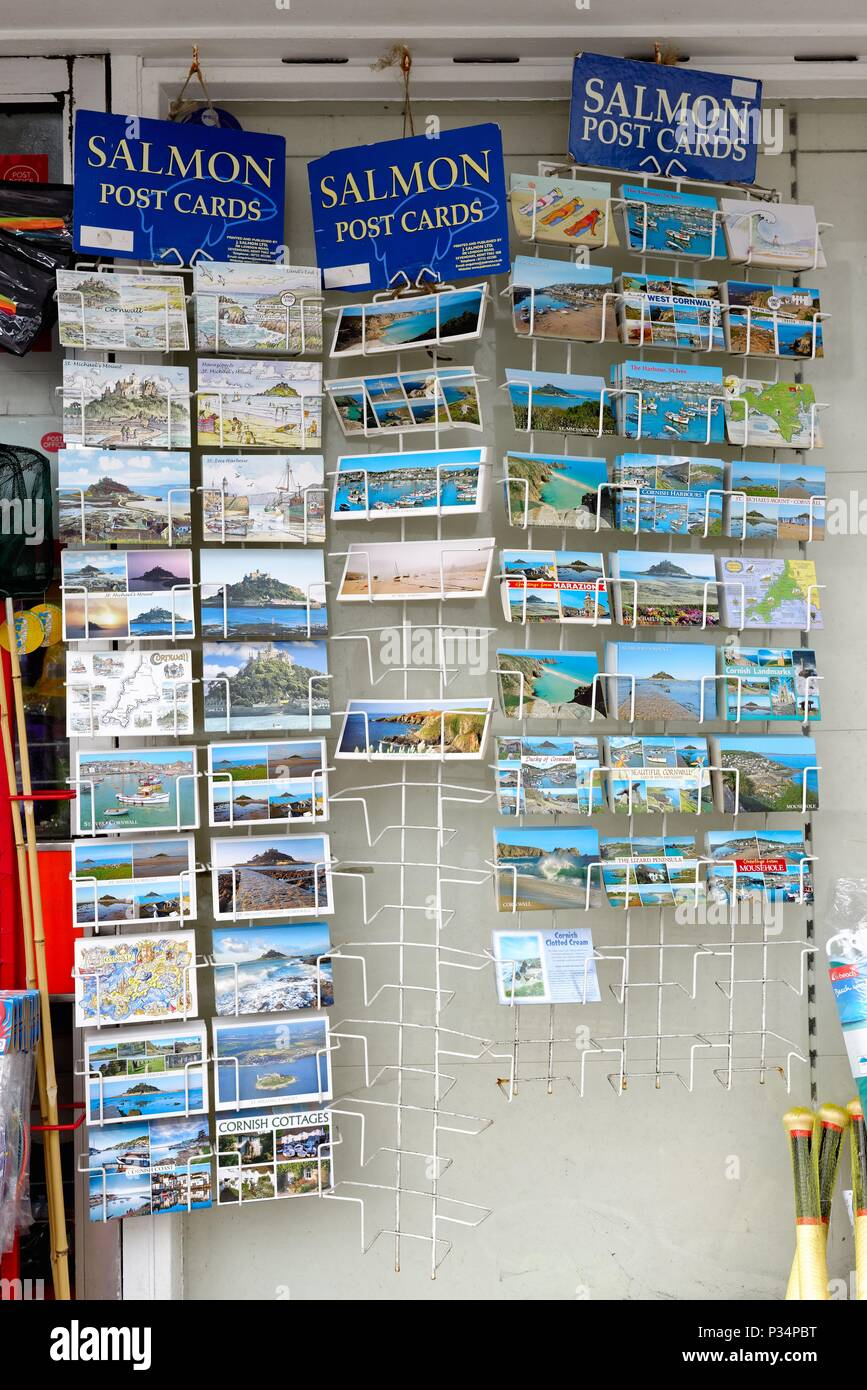 Close up of a rack of holiday postcards outside a seaside shop in Cornwall England UK - Stock Image