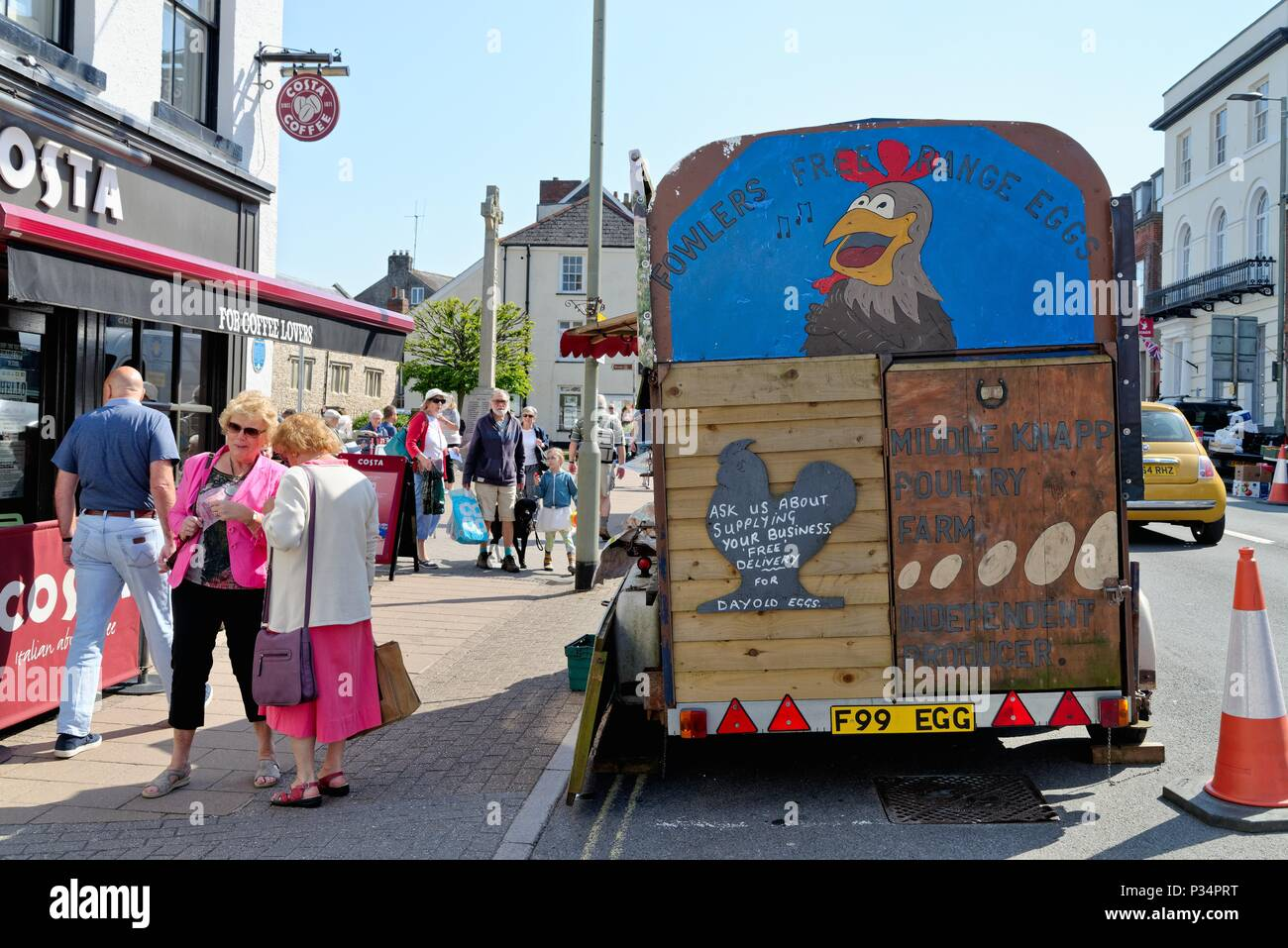 Busy Honiton High Street on a sunny summers day, East Devon England UK Stock Photo