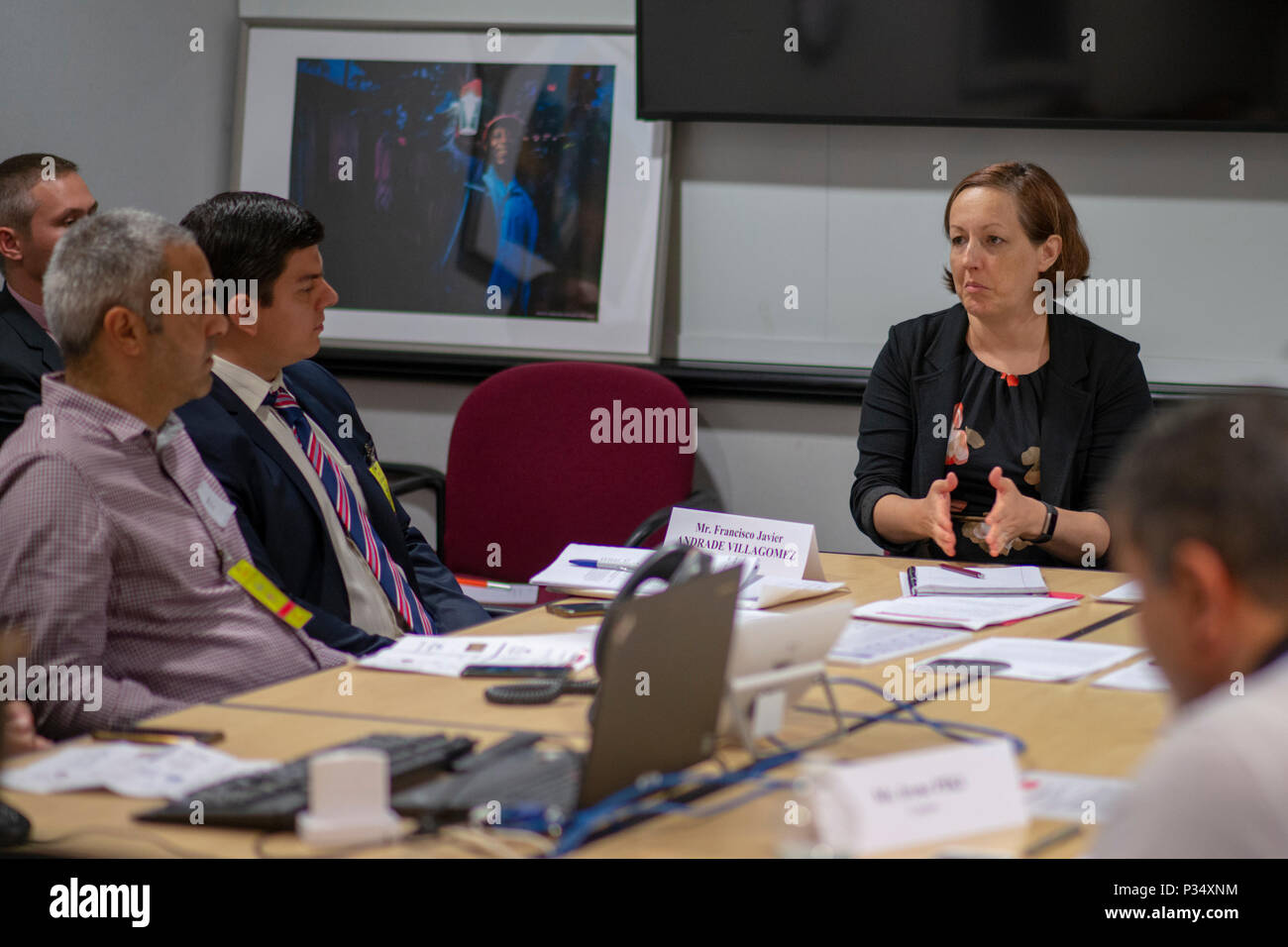 US Agency for International Development private sector engagement specialist, Autumn Gorman, right, discusses entrepreneurship and small business development with representatives from 22 different countries during a visit from the Department of State's International Visitor Leadership Program in Washington, D.C., June 12, 2018. (USAID photo by Mark Burrell) - Stock Image