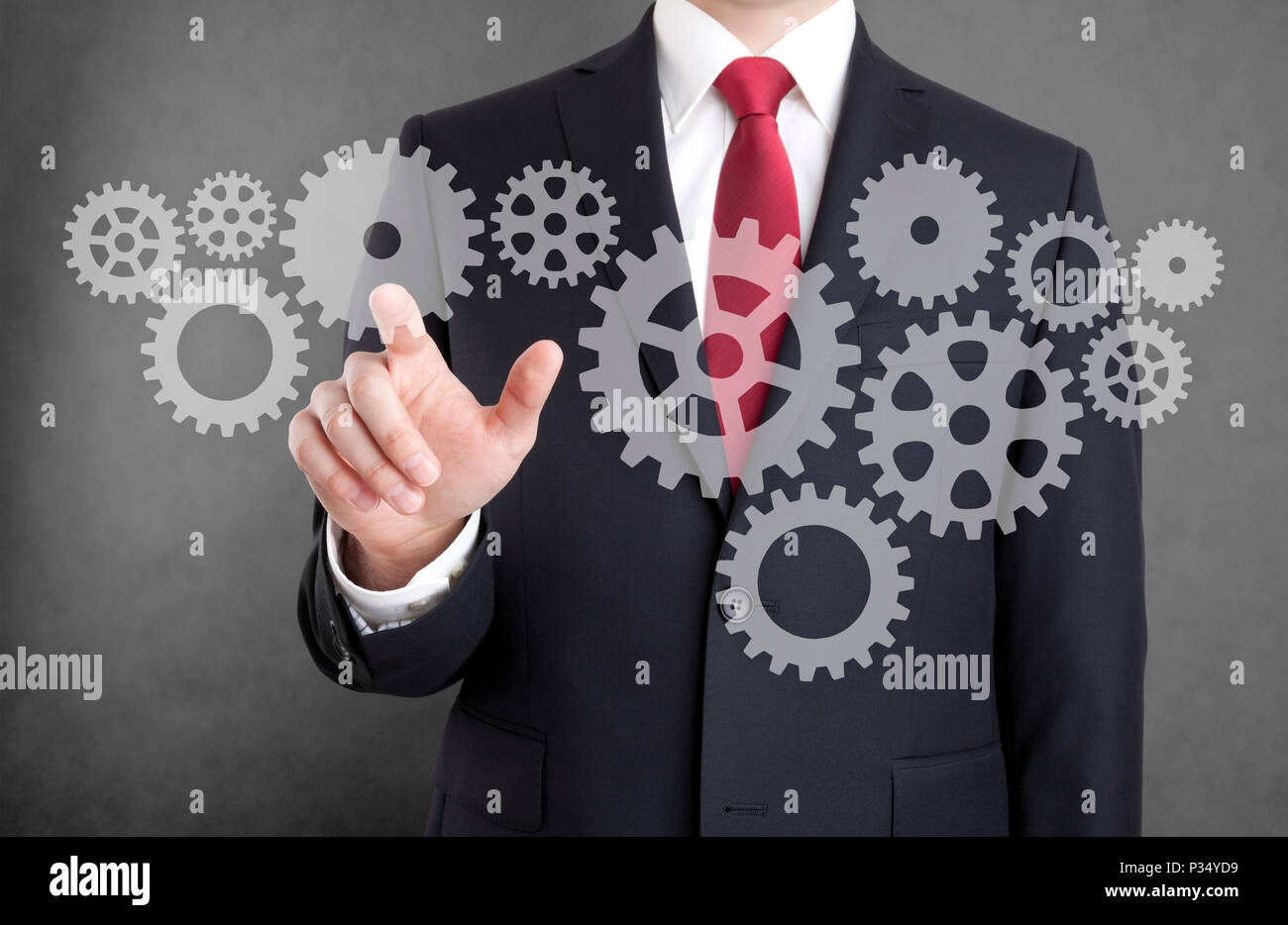 Businessman with gears, concept of well organized work process. - Stock Image
