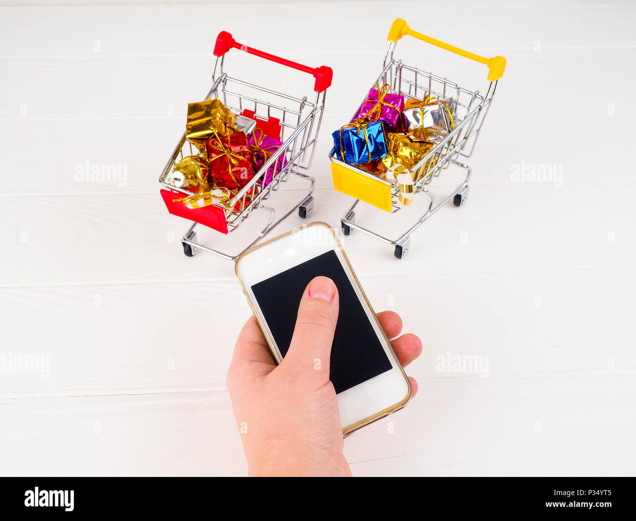 trolley for supermarket and mobile phone, the concept of online shopping in the Internet. - Stock Image