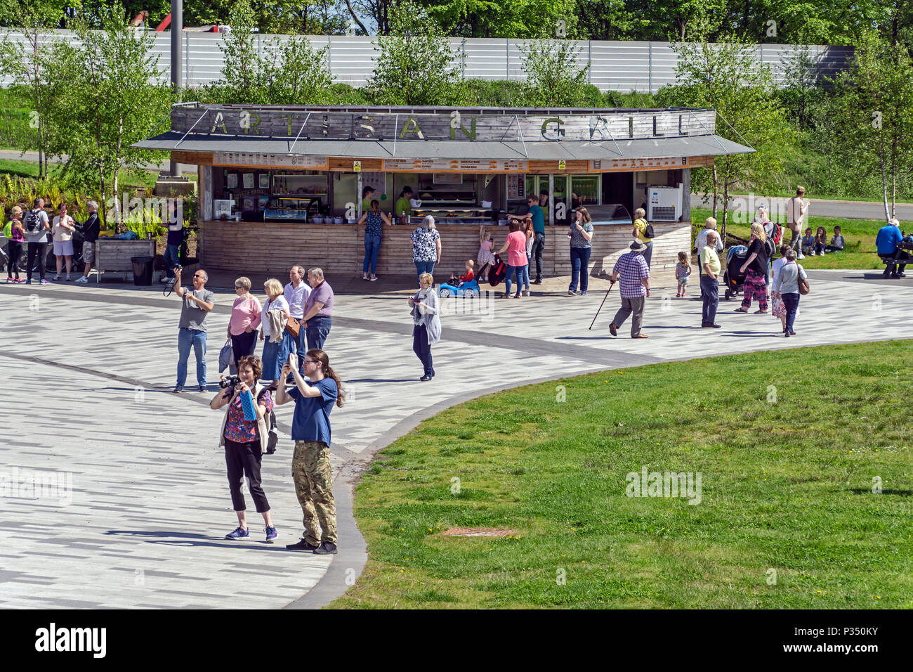 The Artisan Grill at The Helix park in Falkirk near Grangemount in Scotland UK with visitors taking pictures of the Kelpies. - Stock Image