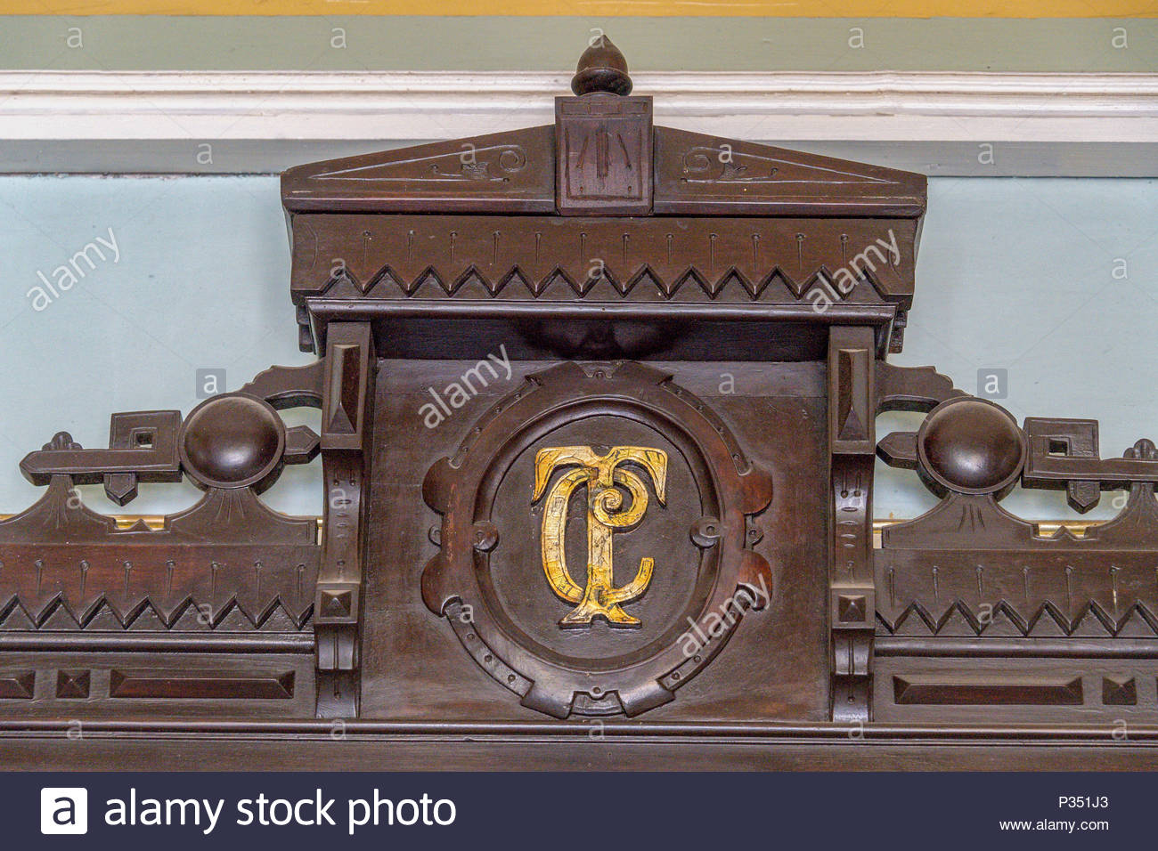 Logo of the Charity Theater or Teatro Caridad engraved on wooden upper part  of an antique furniture. DATE: July 25, 2016 - Logo Of The Charity Theater Or Teatro Caridad Engraved On Wooden