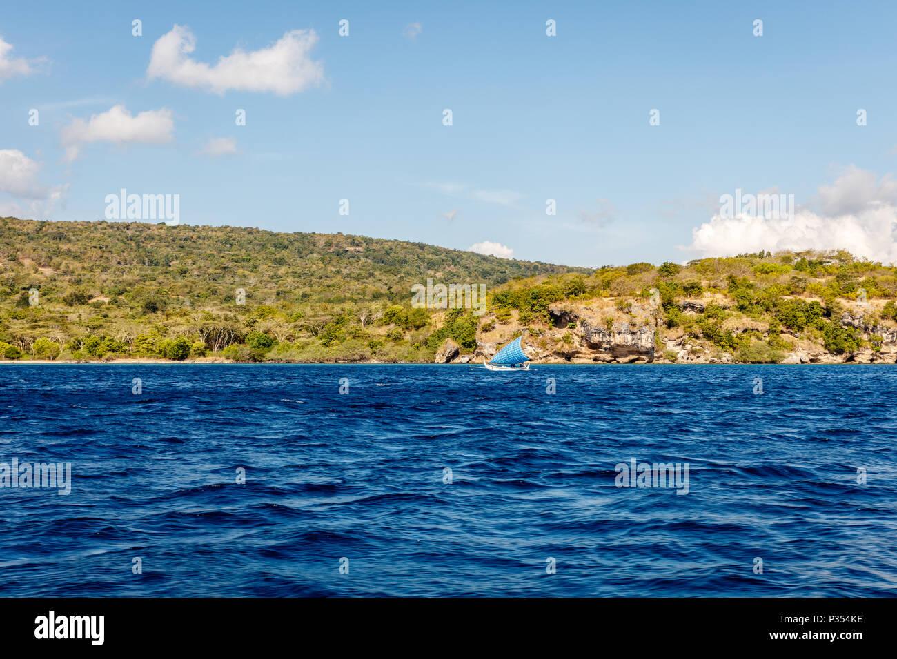 Surroundings of Menjangan Island, West Bali, Indonesia. Seascape, Indian ocean, water, clouds. - Stock Image
