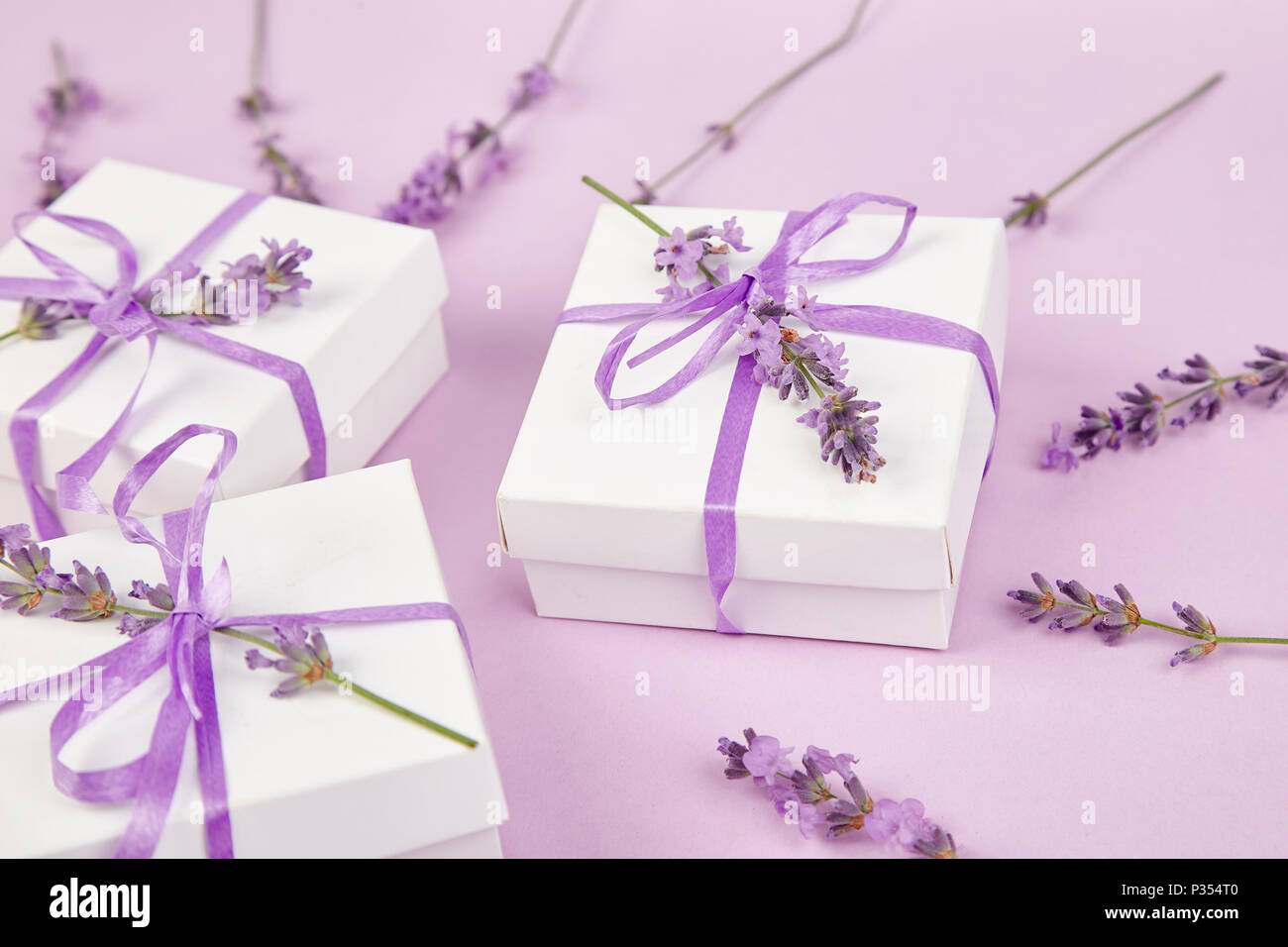 White Gift box with violet ribbon and bouquet of flower lavender on ...