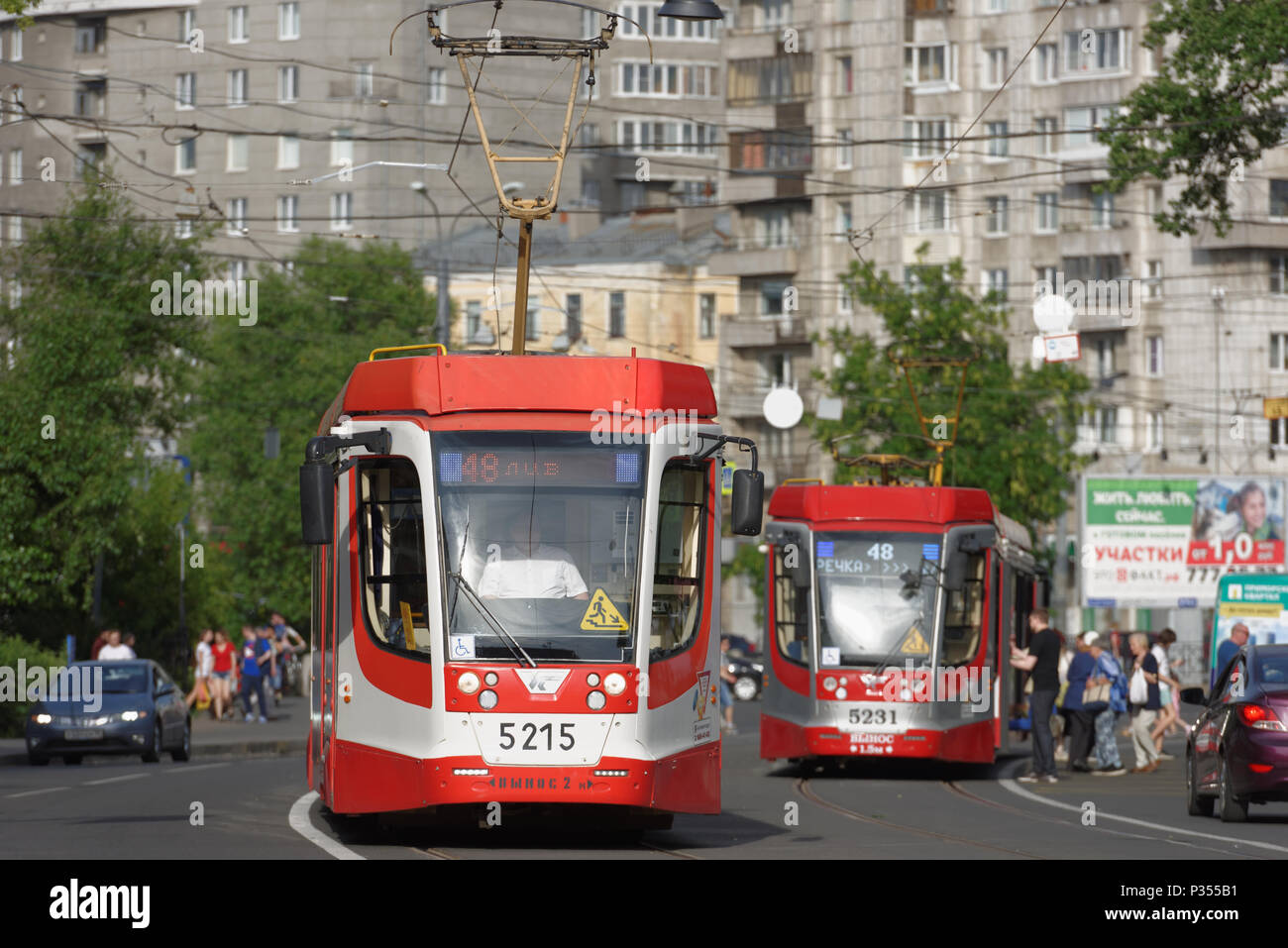 St. Petersburg, Russia - June 16, 2018: Modern tram produced by Ust-Katavsky railroad car building plant on line 48 which services the direction to Sa - Stock Image