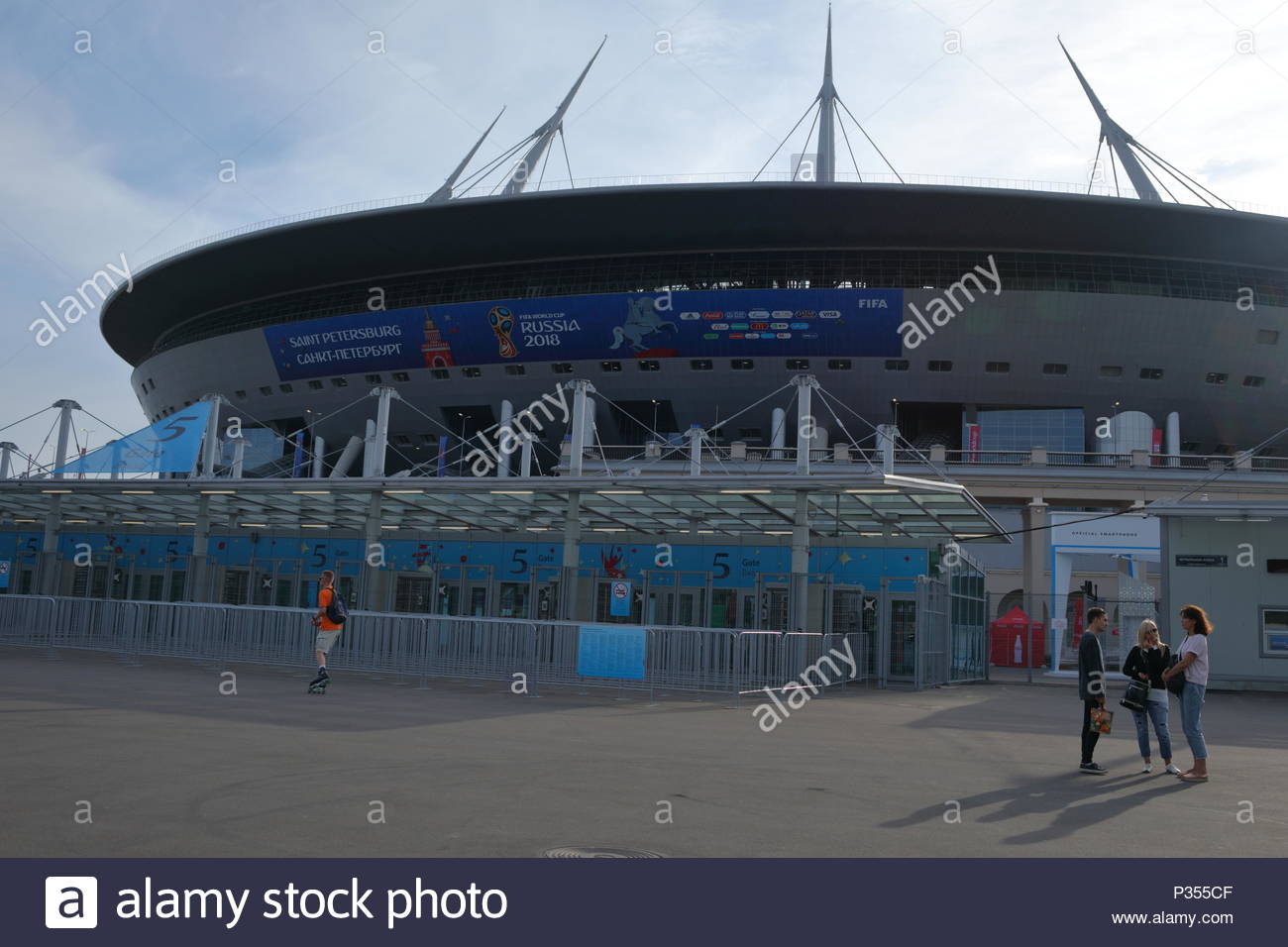 St. Petersburg, Russia - June 16, 2018: People against Saint Petersburg stadium during FIFA World Cup Russia 2018. Saint-Petersburg host 7 matches of  - Stock Image