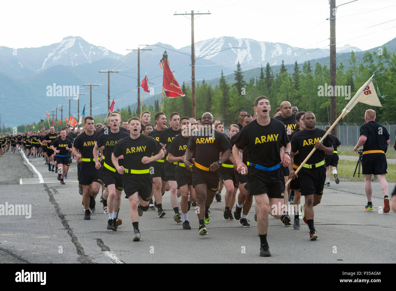 Soldiers assigned to the various U.S. Army Alaska units participate in a large formation run celebrating the Army's 243rd birthday at Joint Base Elmendorf-Richardson, Alaska, June 13, 2018. U.S. Army Alaska Commanding General, Maj. Gen. Mark J. O'Neil and Command Sgt. Maj. Jeffrey R. Dillingham led the Soldiers of USARAK on the run and afterwards a birthday cake cutting ceremony. (U.S. Air Force photo by Alejandro Peña) - Stock Image