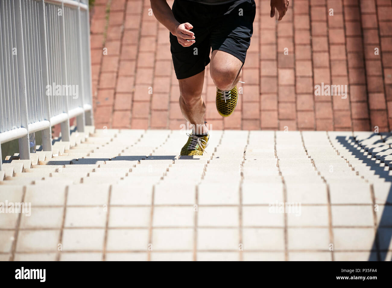 young asian adult male athlete using steps to train speed and strength. Stock Photo