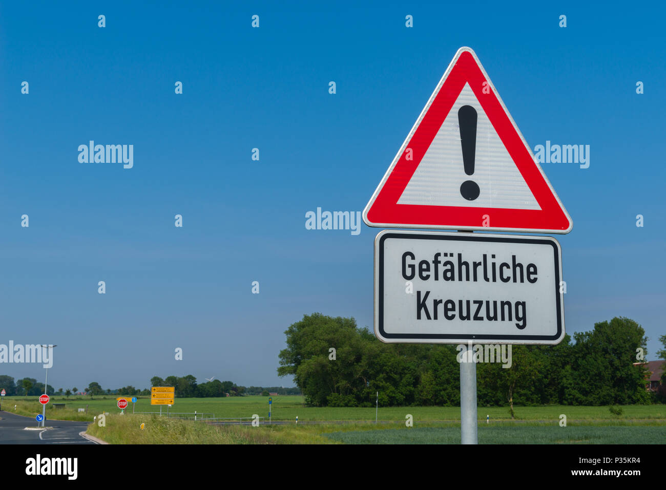 Traffic sign 'Dangerous crossing', Ostrfriesland, Lower Saxony, Germany - Stock Image
