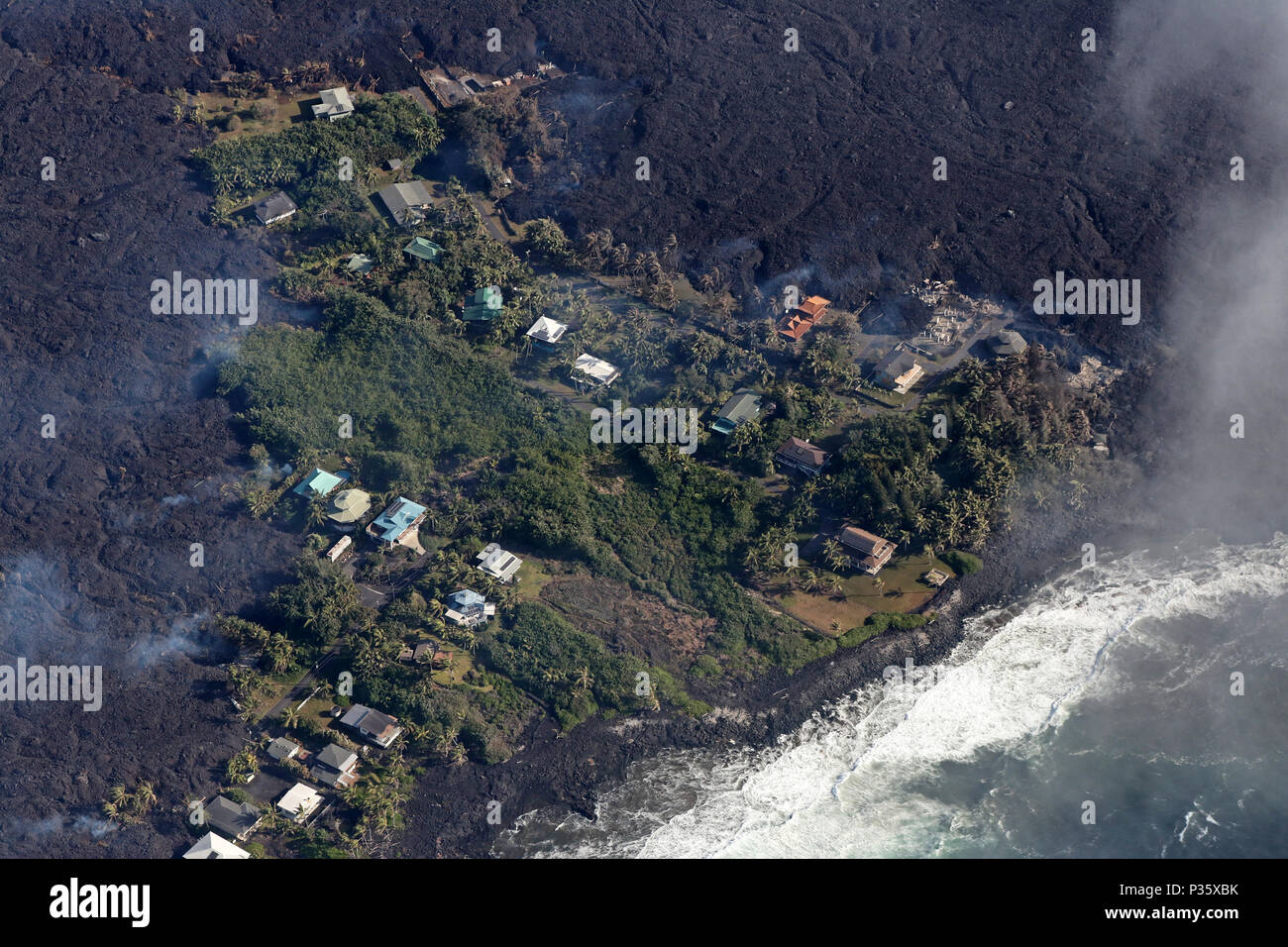The villages of Kapoho and Vacationland are completely enclosed or even destroyed by lava after a volcanic eruption - Stock Image