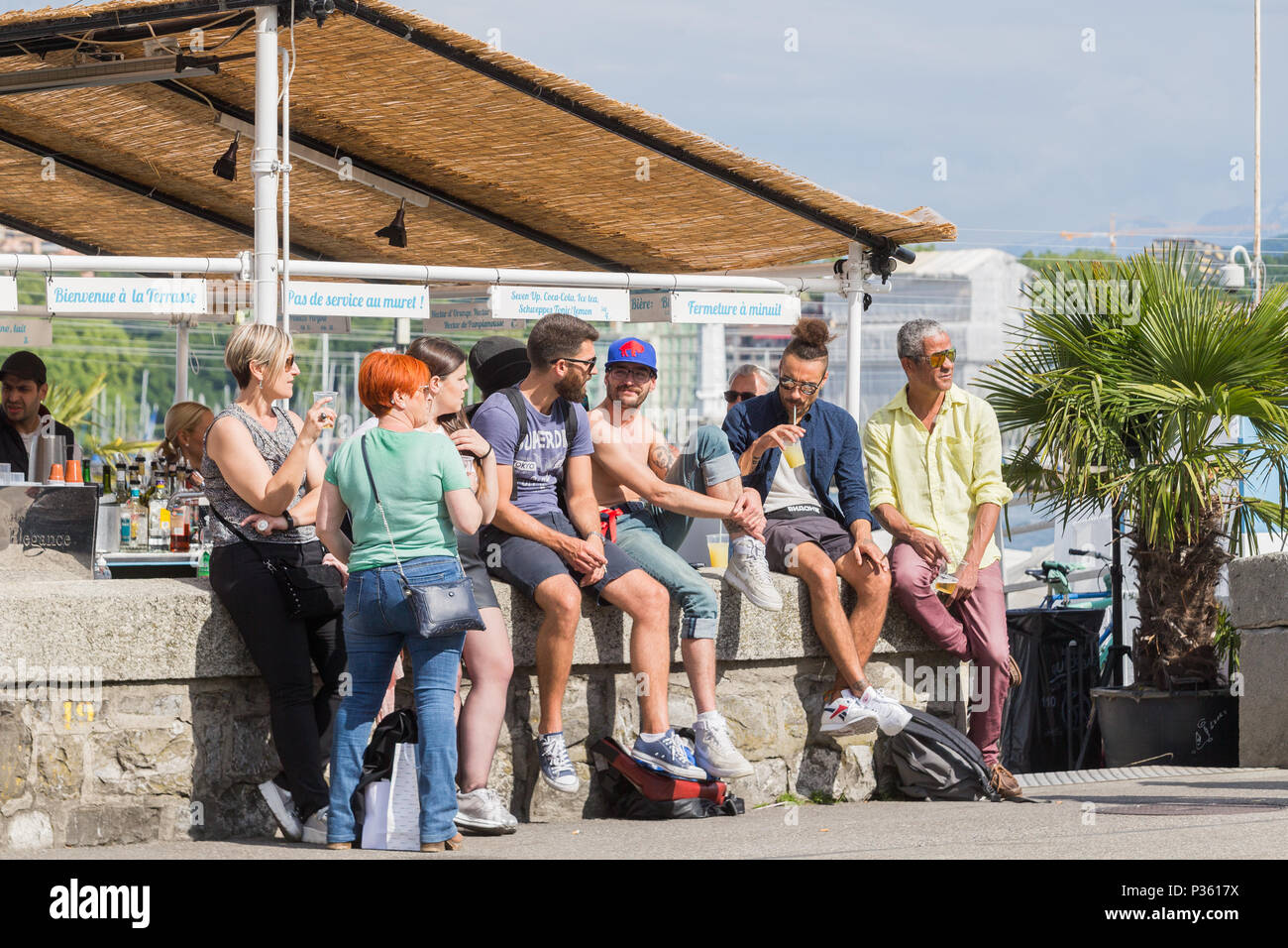 Tourists And Badaux Sitting On The Wall Of The Bar The