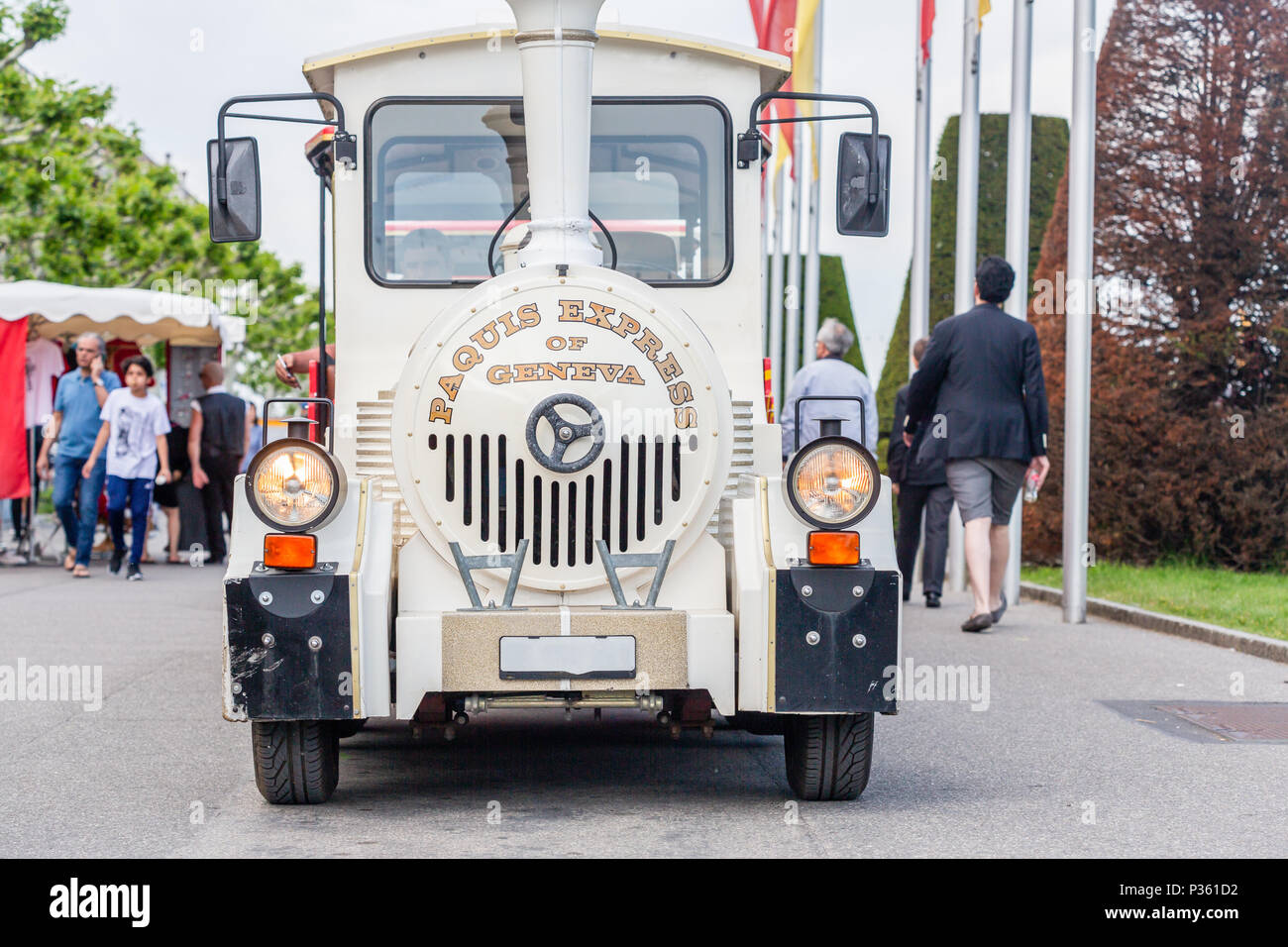Pâquis express de Genève is a small train which is a means of transport so that tourists can see the edge of Lake Geneva . - Stock Image
