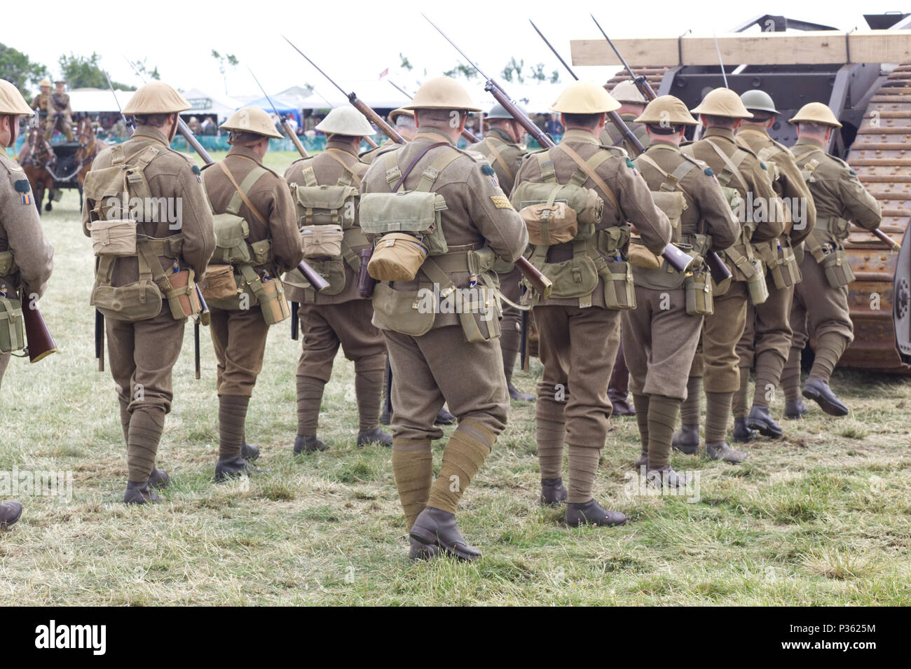 World war 11 Soldiers marching to war behind a  Mark IV tank Lodestar III - Stock Image