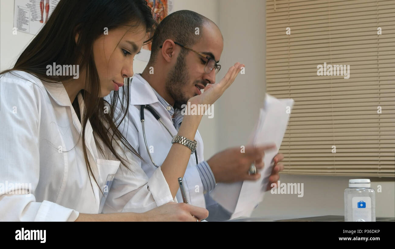 Young nurse and male doctor having an argument in the office - Stock Image