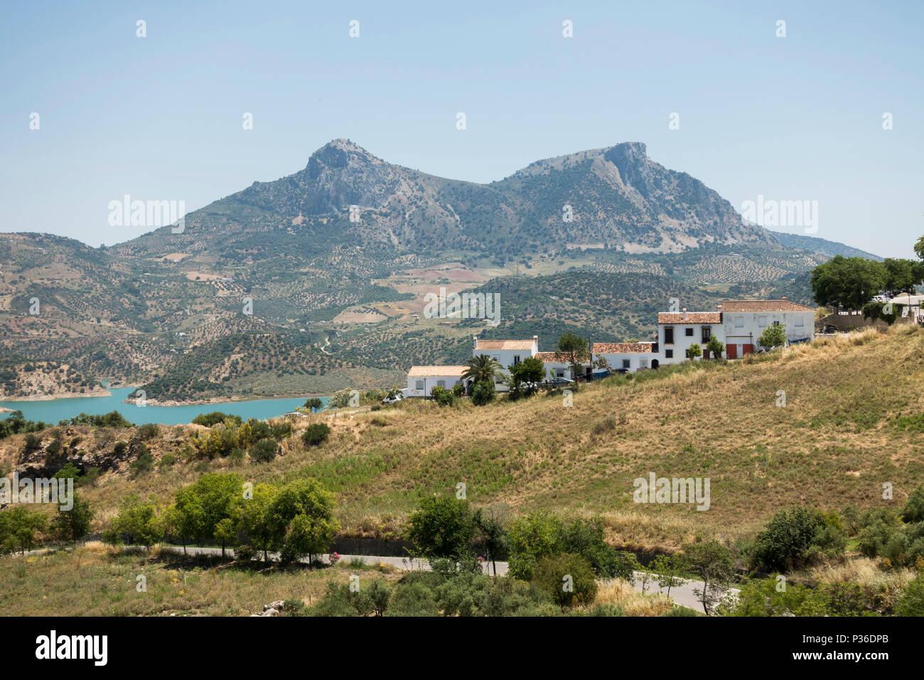 Andalusian village Zahara de la Sierra, with lake, in Sierra de Grazalema Natural Park, Andalucia, Spain - Stock Image
