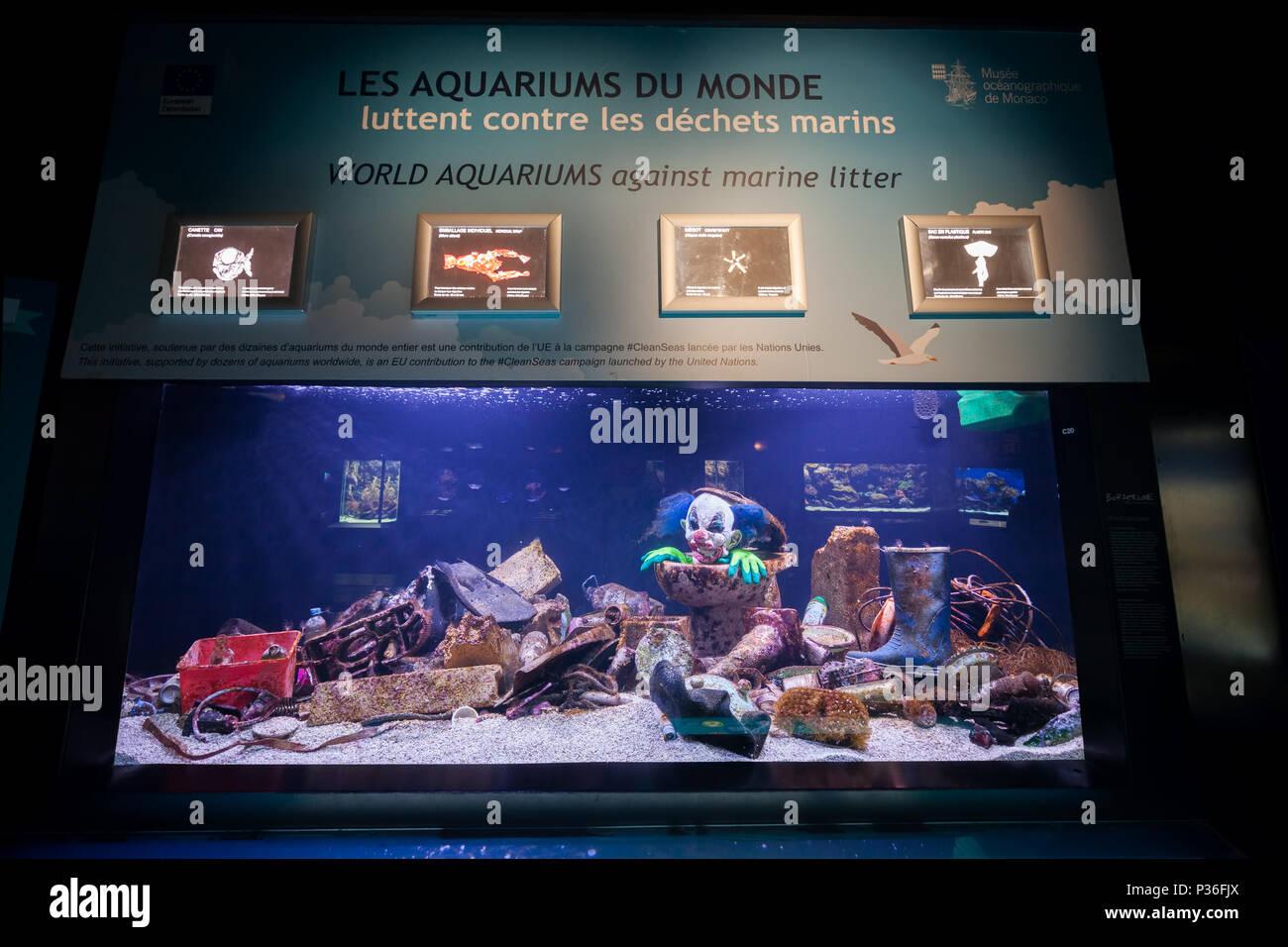 Monaco, fish tank filled with marine litter in Oceanographic Museum Aquarium - Stock Image