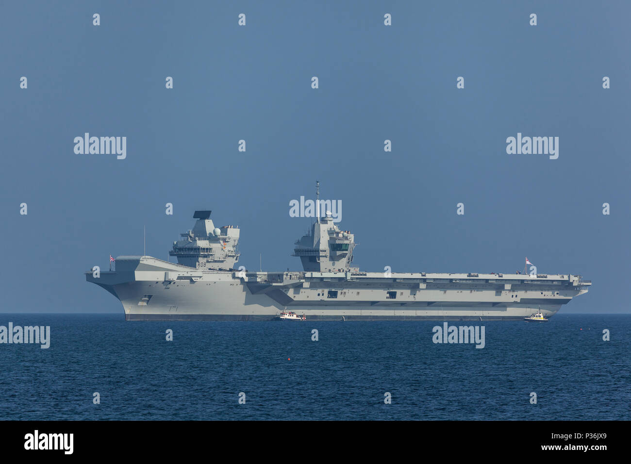 HMS Queen Elizabeth waiting while being loaded by Cornish Coast (Newlyn) - Stock Image
