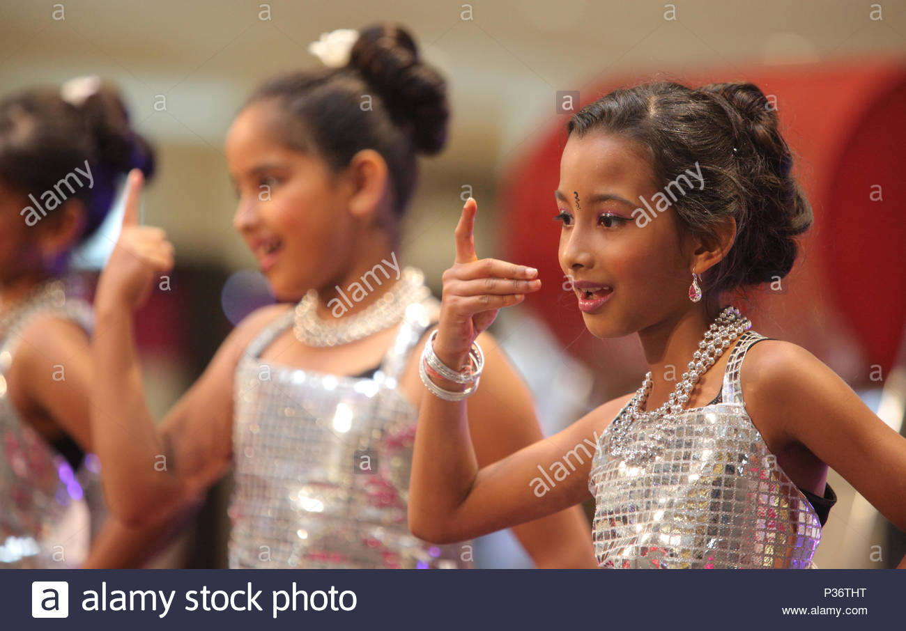 Young Indian girls perform a Bollywood dance during a Diwali dance competition held in Brampton, Ontario, Canada. - Stock Image