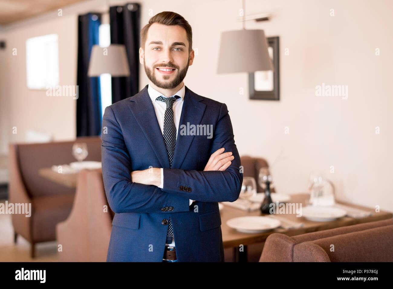 Bearded restaurateur in formal suit - Stock Image