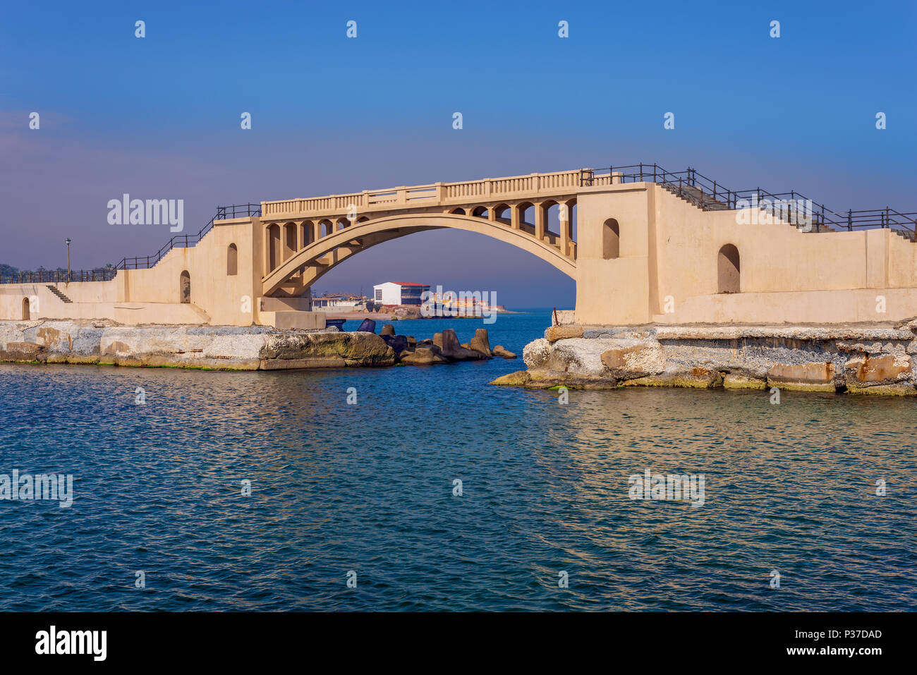 Bridge in the sea at Montazah park with calm sea and clear sky at sunrise time, Alexandria, Egypt - Stock Image