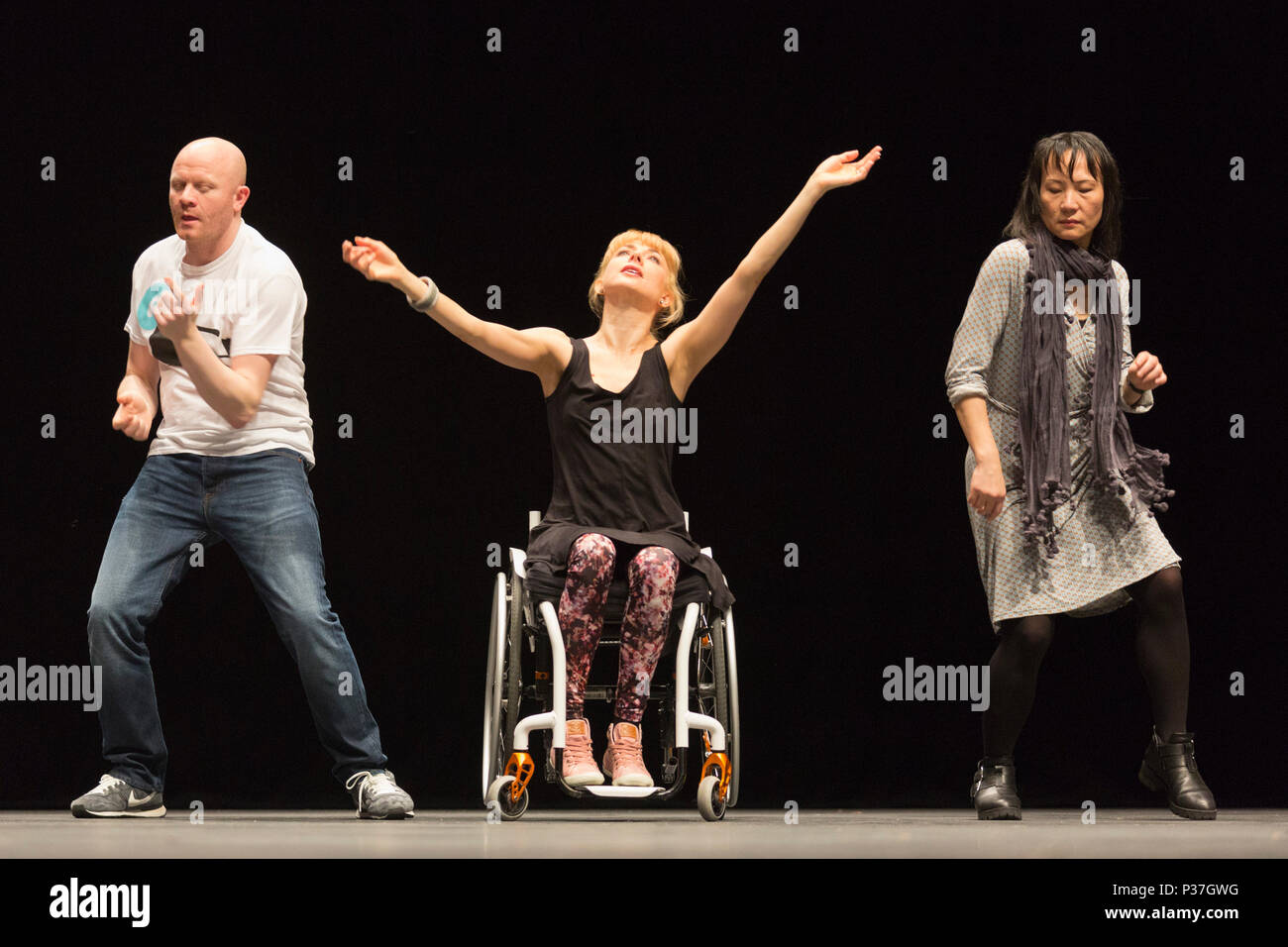 London, UK. 20 March 2015.  L-R: Gary Clarke. Suzie Birchwood and Jia-Yu Corti. Sadler's Wells presents a weekend of inclusive dance from 20 to 22 March 2015. Candoco Dance Company, a contemporary dance comapny of disabled and non-disabled performers presents a restaging of Jerome Bel's award-winning The Show Must Go On. The weekend also includes the final performances of the inaugural year of the Sadler's Wells =dance series, a presentation of inclusive dance by both established and emerging deaf and disabled artists in the Lilian Baylis Studio. Stock Photo