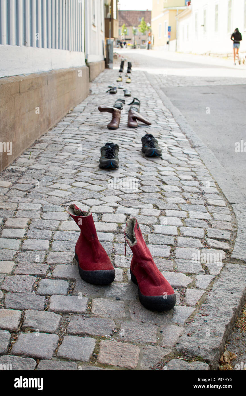 d353ebedac0d Old shoes in a row on sidewalk Stock Photo  208536138 - Alamy