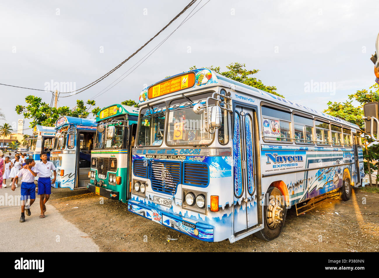 Colourful parked Lanka Ashok Leyland coaches used to take local schoolchildren on excursions to Galle Fort, Galle, Southern Province, Sri Lanka Stock Photo
