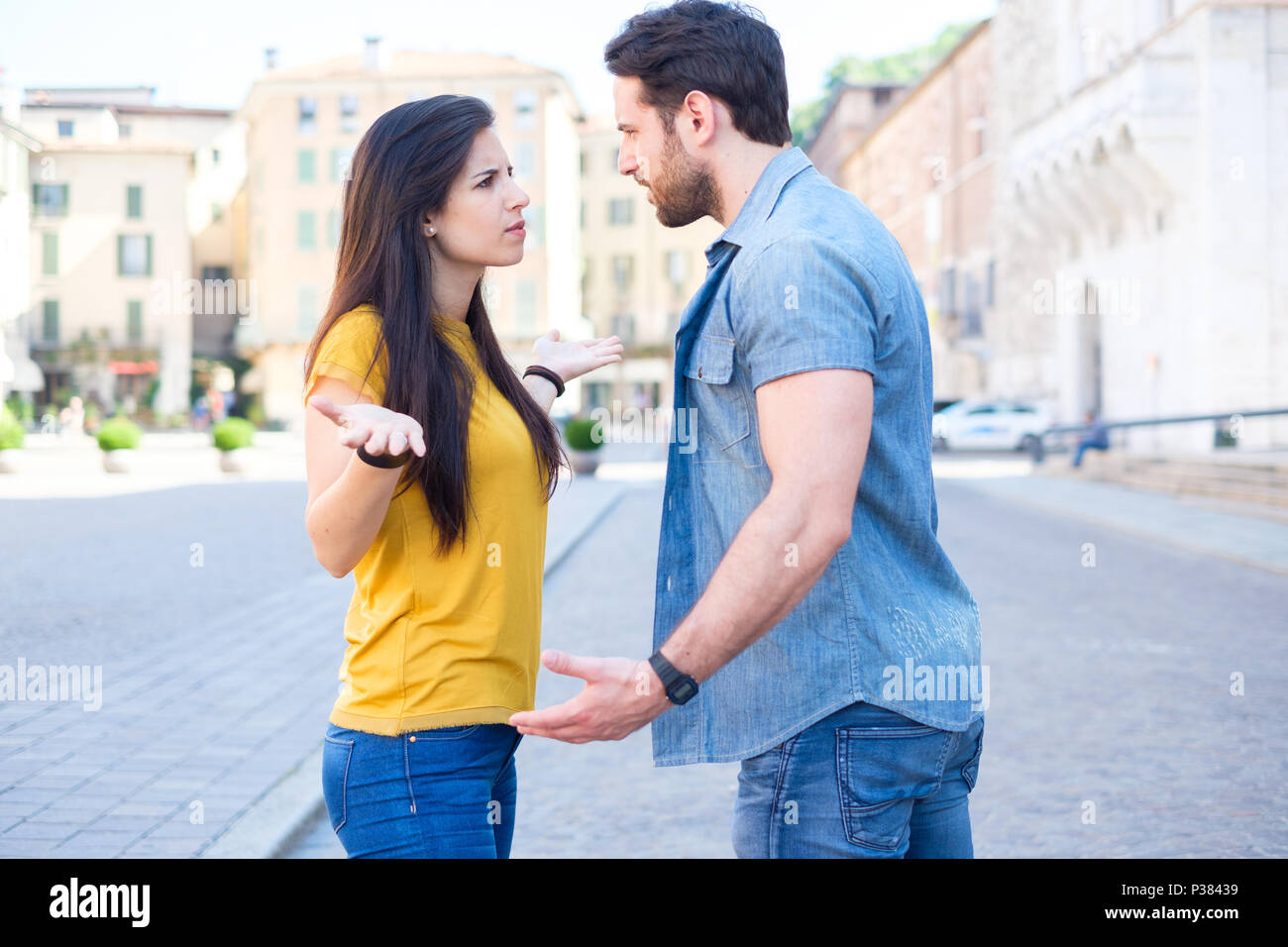 Young couple arguing at the street , relationship problems - Stock Image