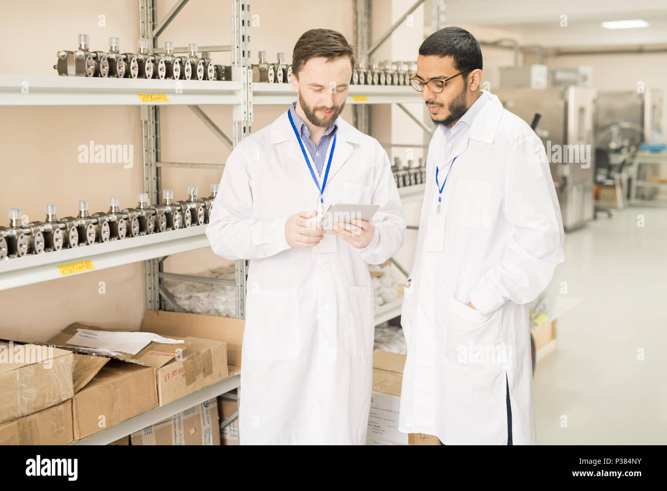 Teamwork at Warehouse of Measuring Equipment Factory - Stock Image
