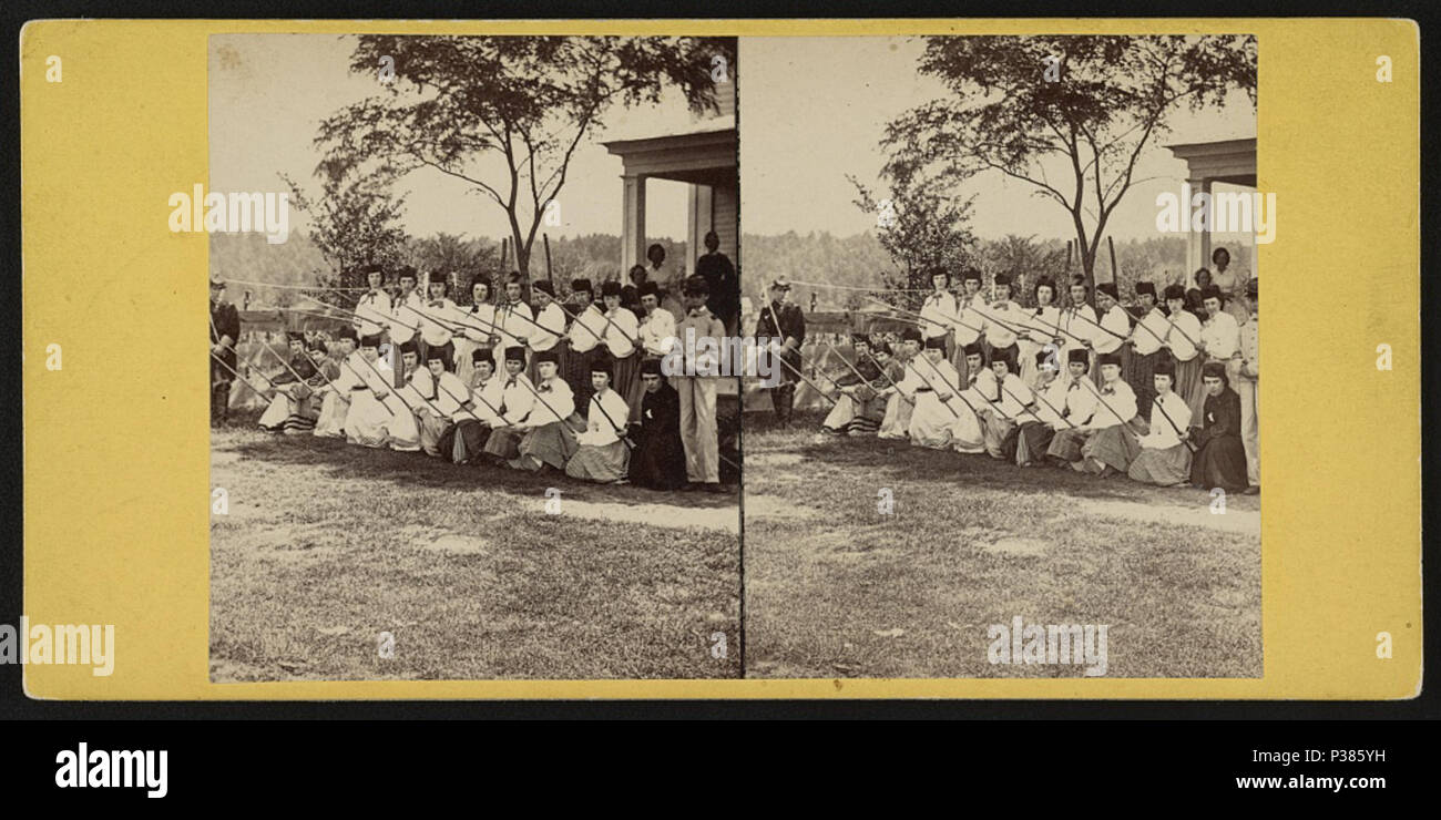 7023afeab2e . English   The home guard  White Mountain rangers . English  Stereograph  shows a group of women kneeling and ...