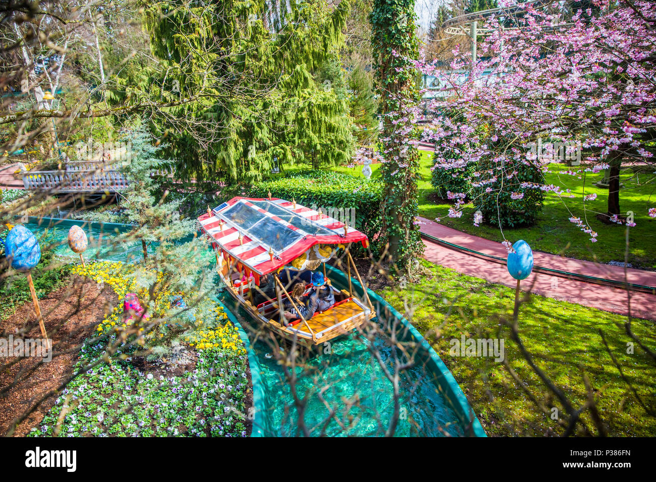 RUST, GERMANY - March 31, 2018 - Guests riding boats in Europa-Park. Europa-Park is a second largest park resort in Europe. - Stock Image