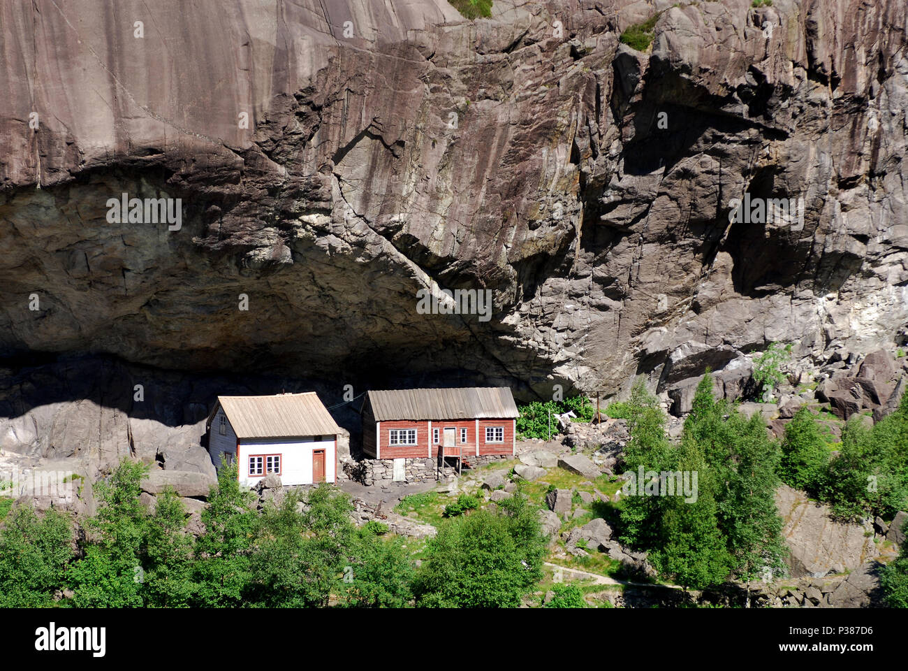Brighter, Norway, old houses under a ledge Stock Photo
