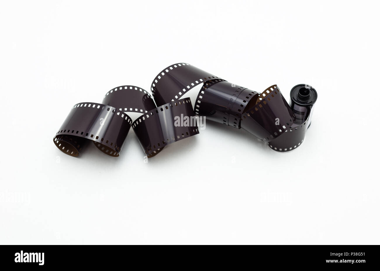 35mm photo film rolls. Isolated on white background. Stock Photo