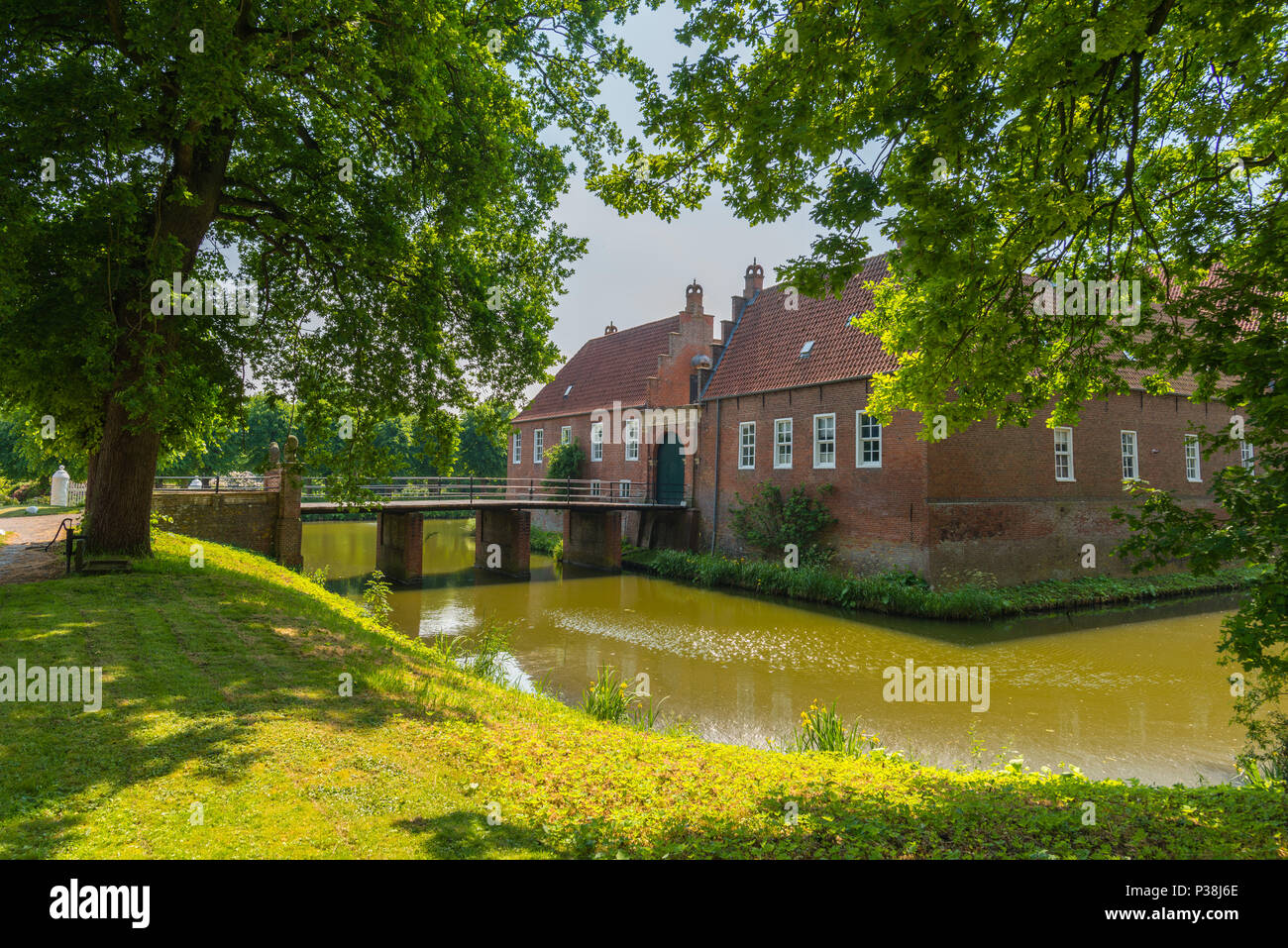 Moated castle  Castle Hinta, former seat of an East Frisian chieftain,  Hinte, East Frisia, Lower Saxony, Germany - Stock Image