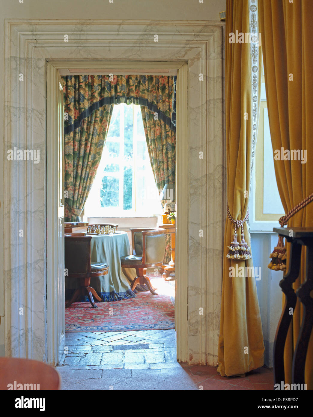 Ochre Velvet Curtains Beside Marble Effect Door To Tuscan Dining Room With Floral On Window