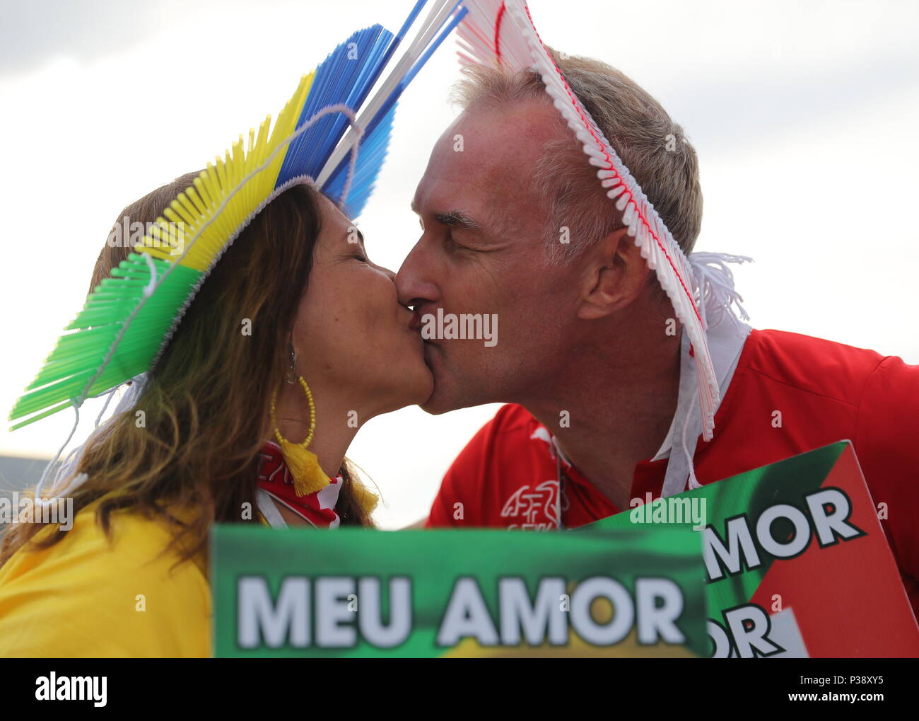Rostov On Don, Russia. 17th June, 2018. ROSTOV-ON-DON, RUSSIA - JUNE 17, 2018: Brazilian football fans kiss before a First Stage Group E football match between Brazil and Switzerland at Rostov Arena at FIFA World Cup Russia 2018. Anton Novoderezhkin/TASS Credit: ITAR-TASS News Agency/Alamy Live News Stock Photo
