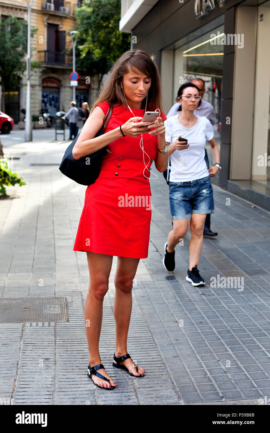 Woman on mobile phone, Barcelona, Spain. - Stock Image