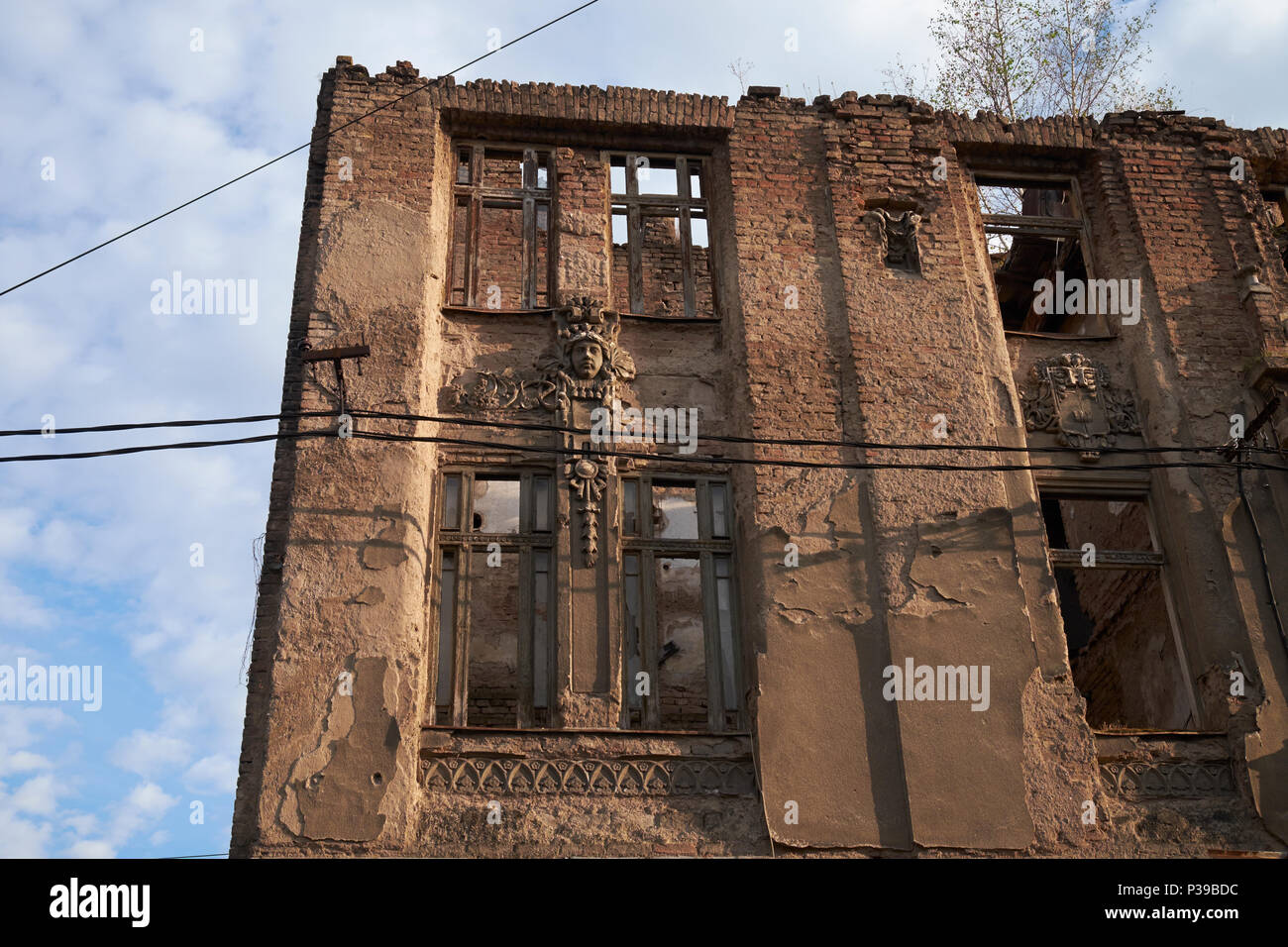 Building damaged during the siege of Sarajevo, Bosnia and Herzegovina, Europe. Like many others. it's the subject of a long-running ownership dispute. - Stock Image