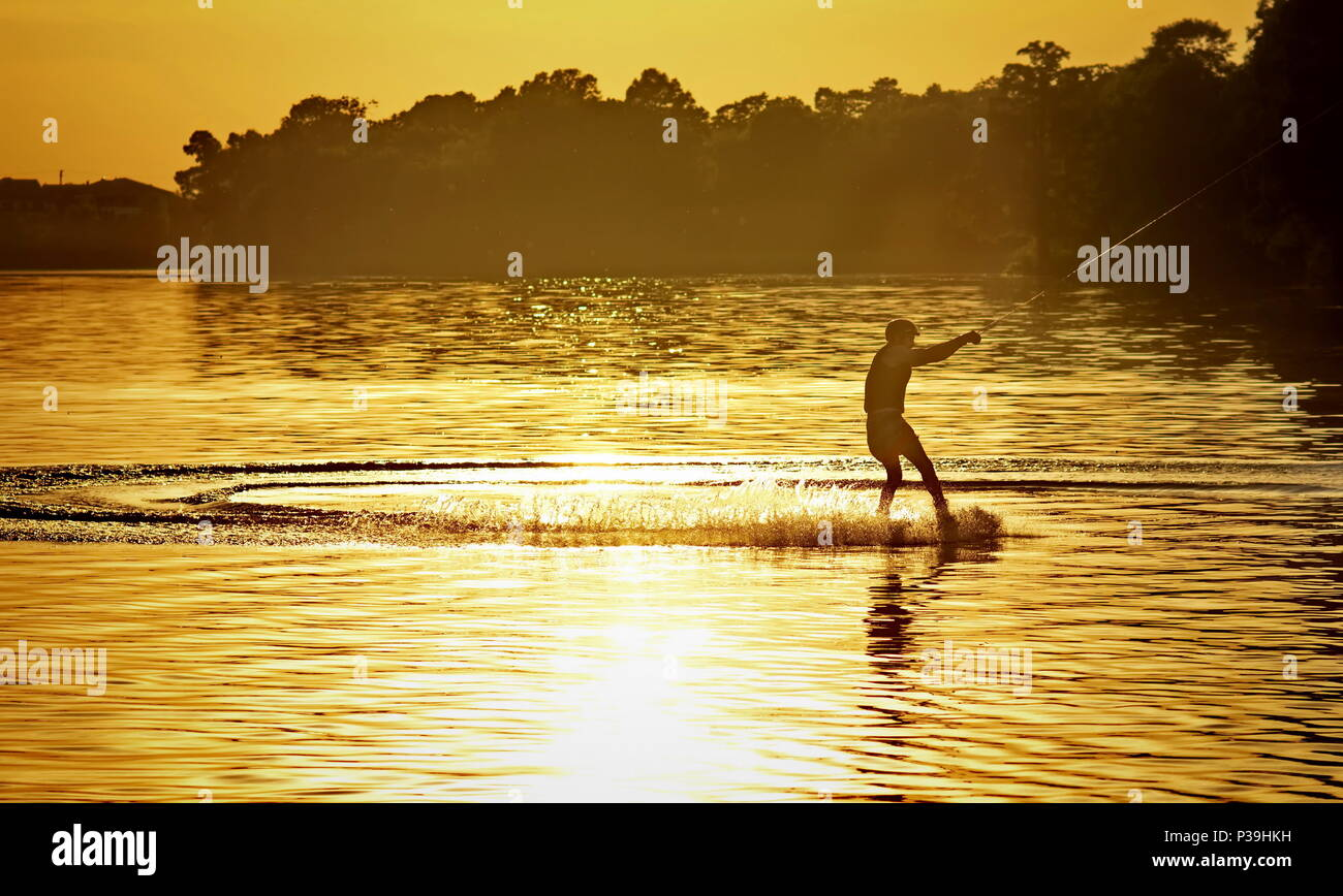 wakeboarder athlete doing wakeboard and wakeboarding jump - Stock Image