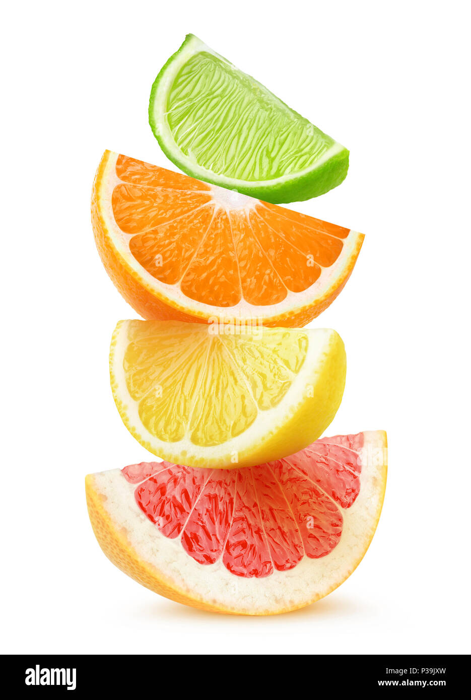 Isolated citrus slices. Pieces of grapefruit, orange, lemon and lime fruits on top of each other isolated on white background with clipping path Stock Photo